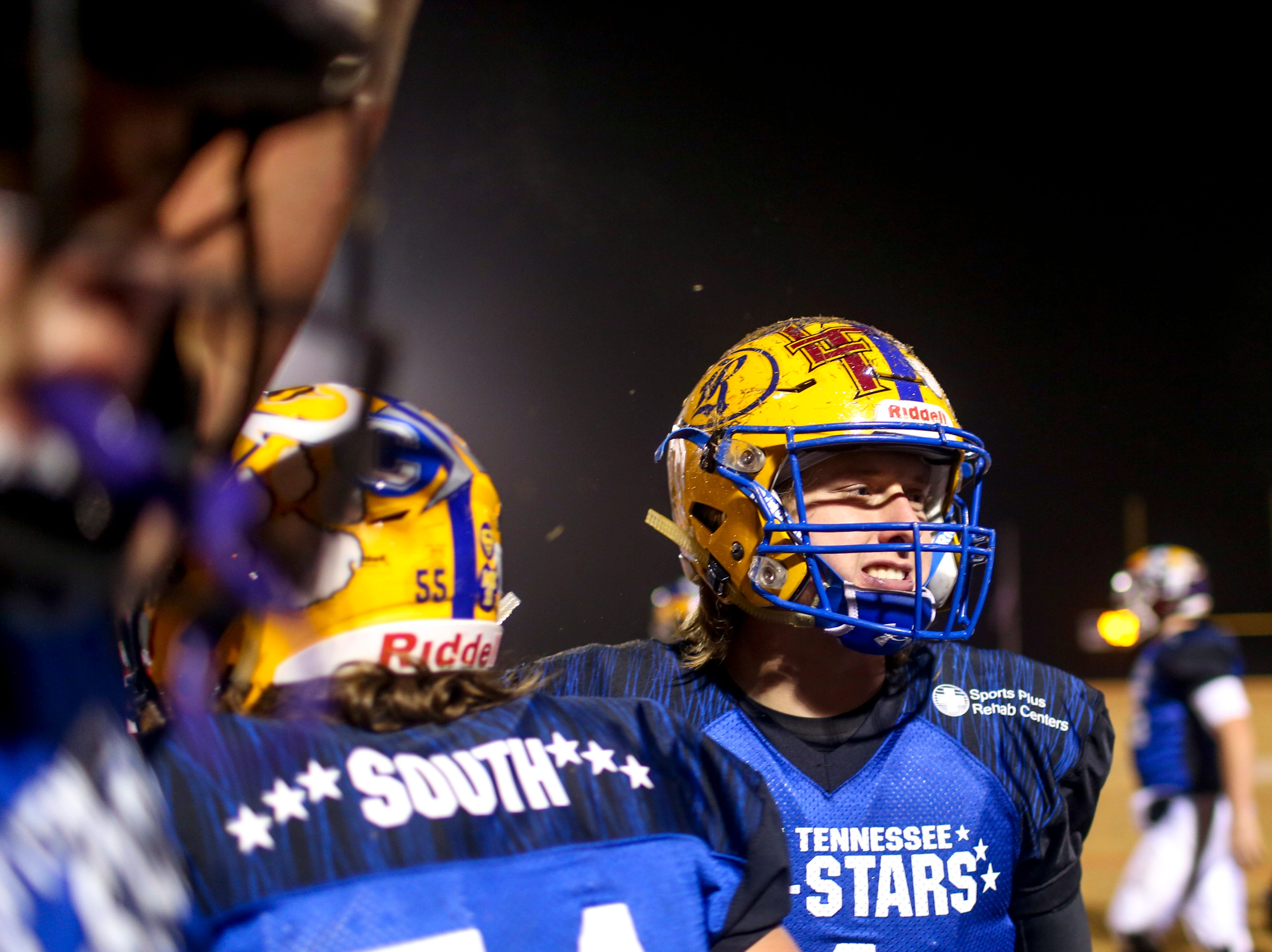 Riverside's Stone Frost (4) celebrates with teammates on the sidelines during the West Tennessee All-Star football game at University School of Jackson in Jackson, Tenn., on Friday, Dec. 7, 2018.