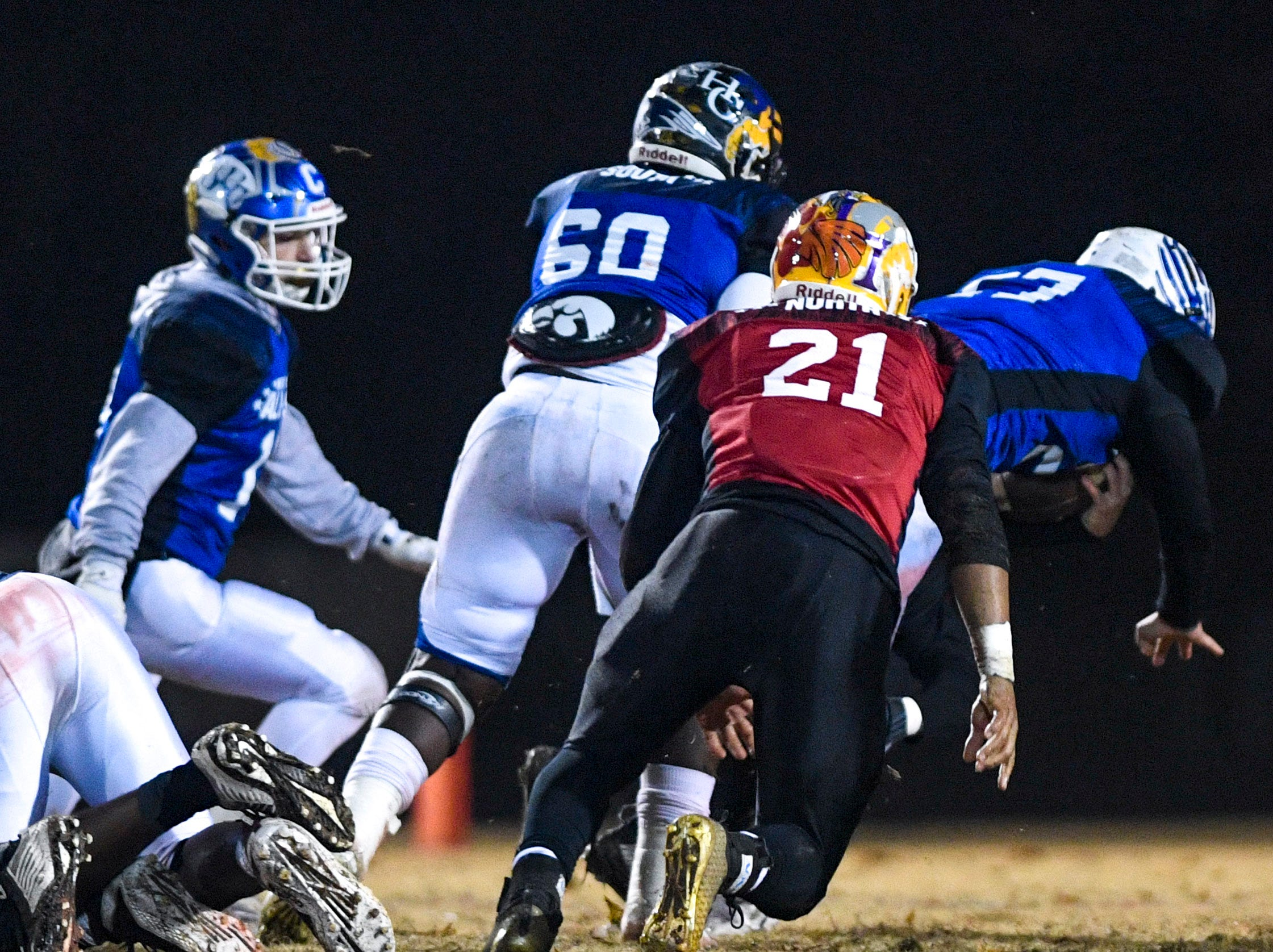 Players swarm after Chester Co's Peyton Doles (27) after Doles recovered a fumble during the West Tennessee All-Star football game at University School of Jackson in Jackson, Tenn., on Friday, Dec. 7, 2018.