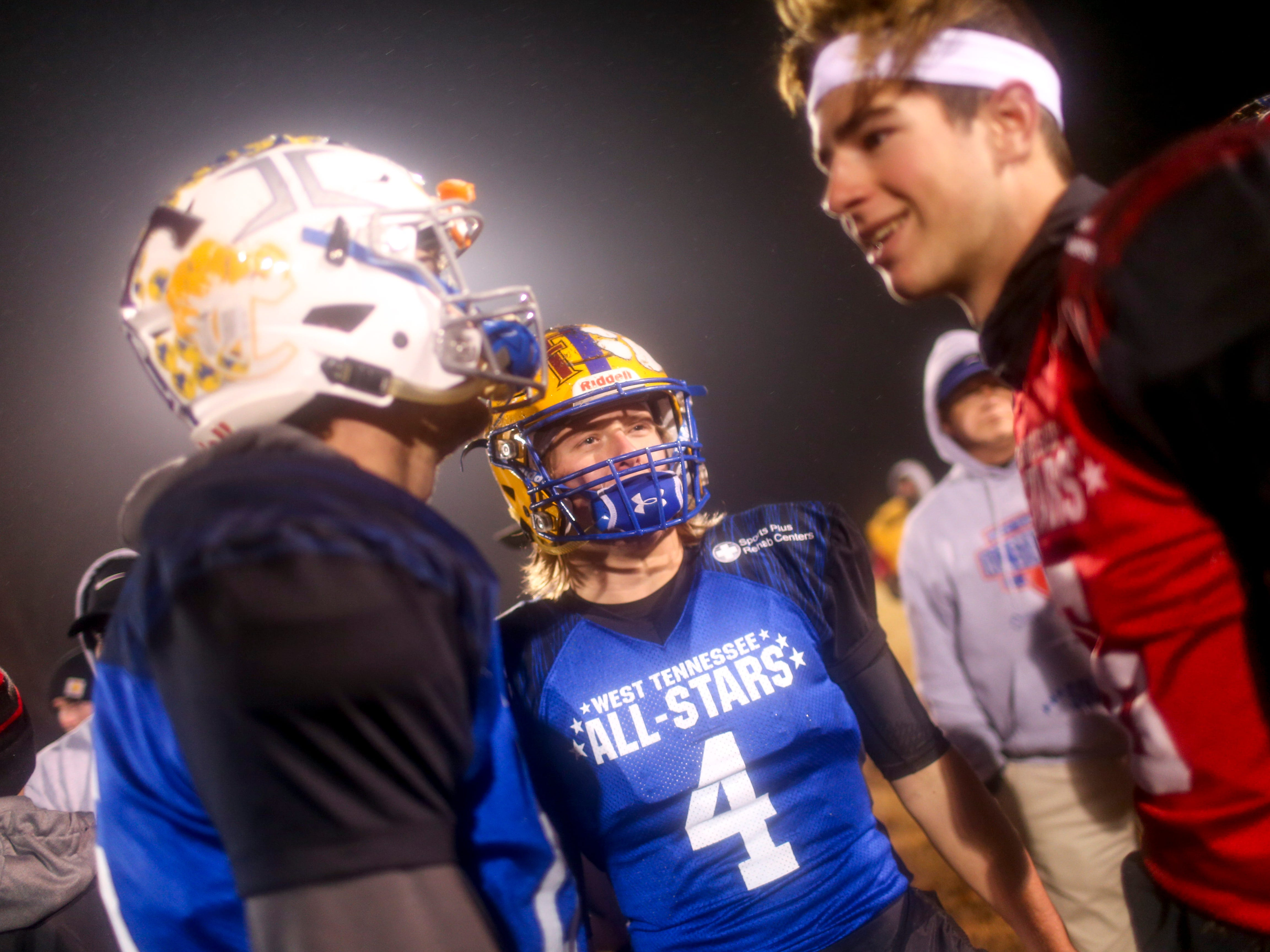 Riverside's Stone Frost (4) chats with other players from the game during the West Tennessee All-Star football game at University School of Jackson in Jackson, Tenn., on Friday, Dec. 7, 2018.
