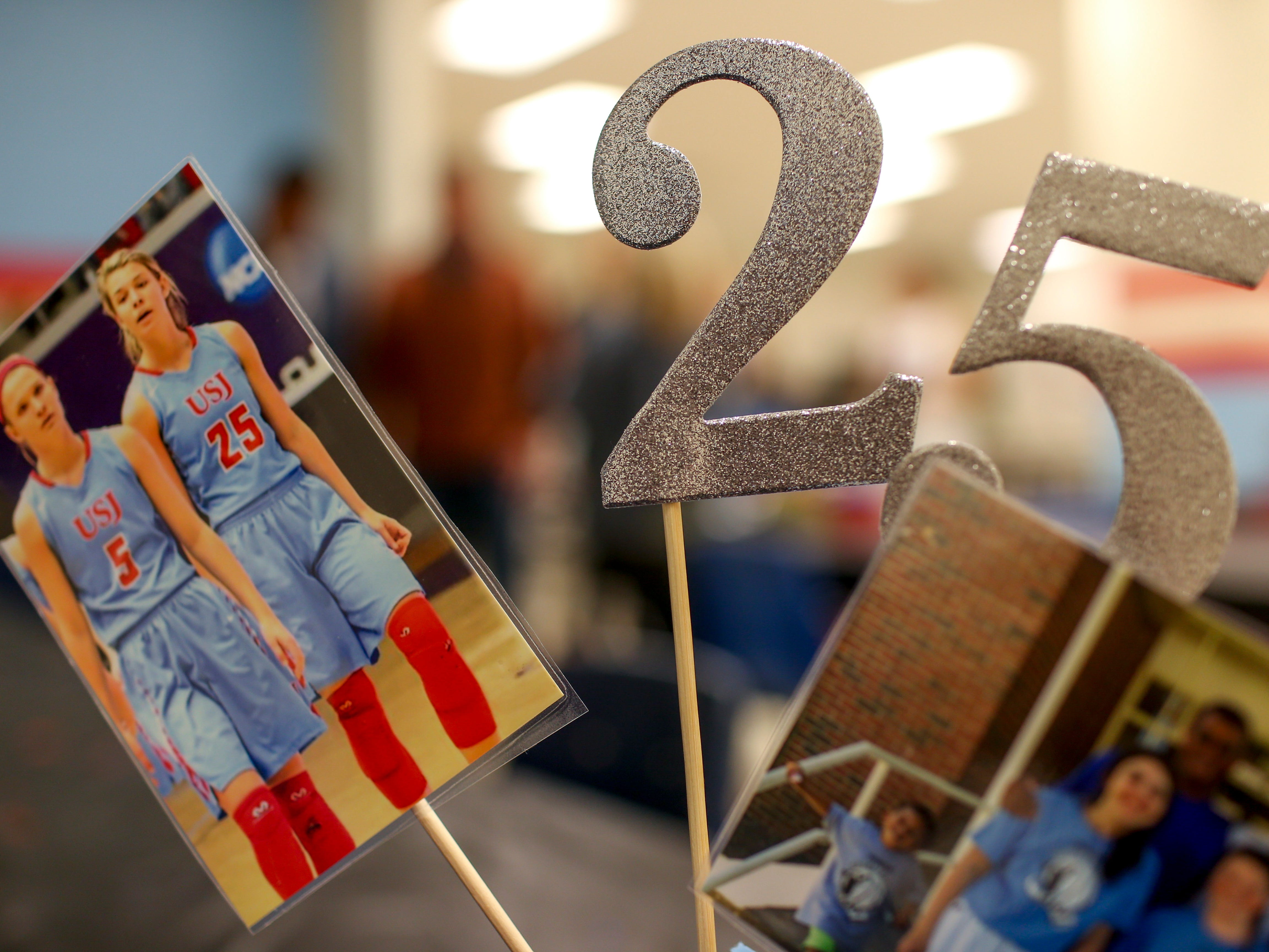 Decorations with the number 25 and old photos of Anna Jones were displayed during the retirement of Jones' old jersey number 25 at University School of Jackson in Jackson, Tenn., on Friday, Dec. 7, 2018.