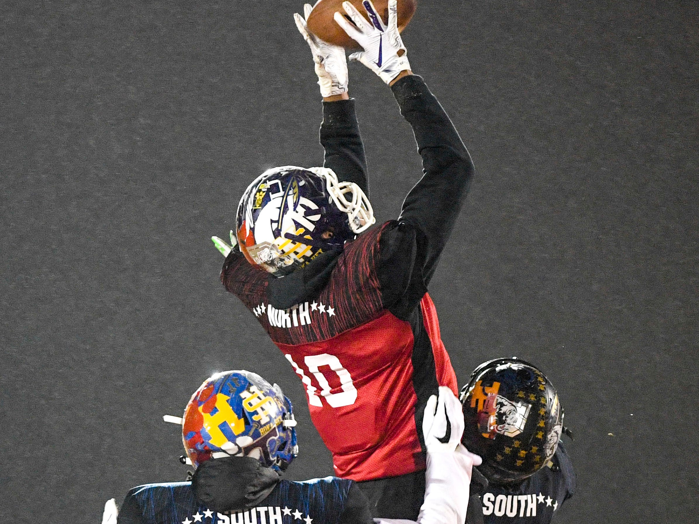 Haywood Co's Taylor Shield's (10) leaps to catch a pass during the West Tennessee All-Star football game at University School of Jackson in Jackson, Tenn., on Friday, Dec. 7, 2018.