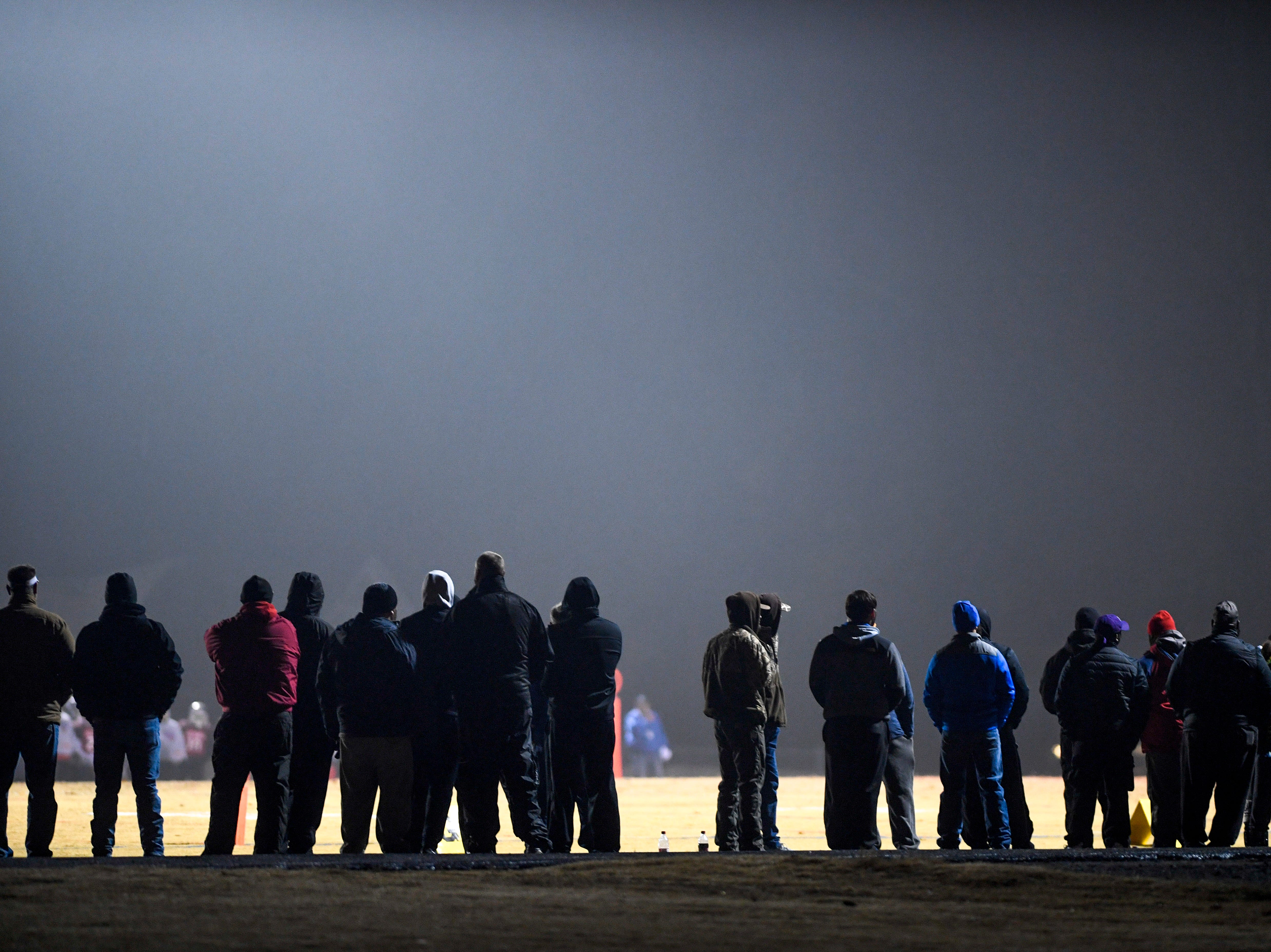 Fans watch from the sidelines during the West Tennessee All-Star football game at University School of Jackson in Jackson, Tenn., on Friday, Dec. 7, 2018.