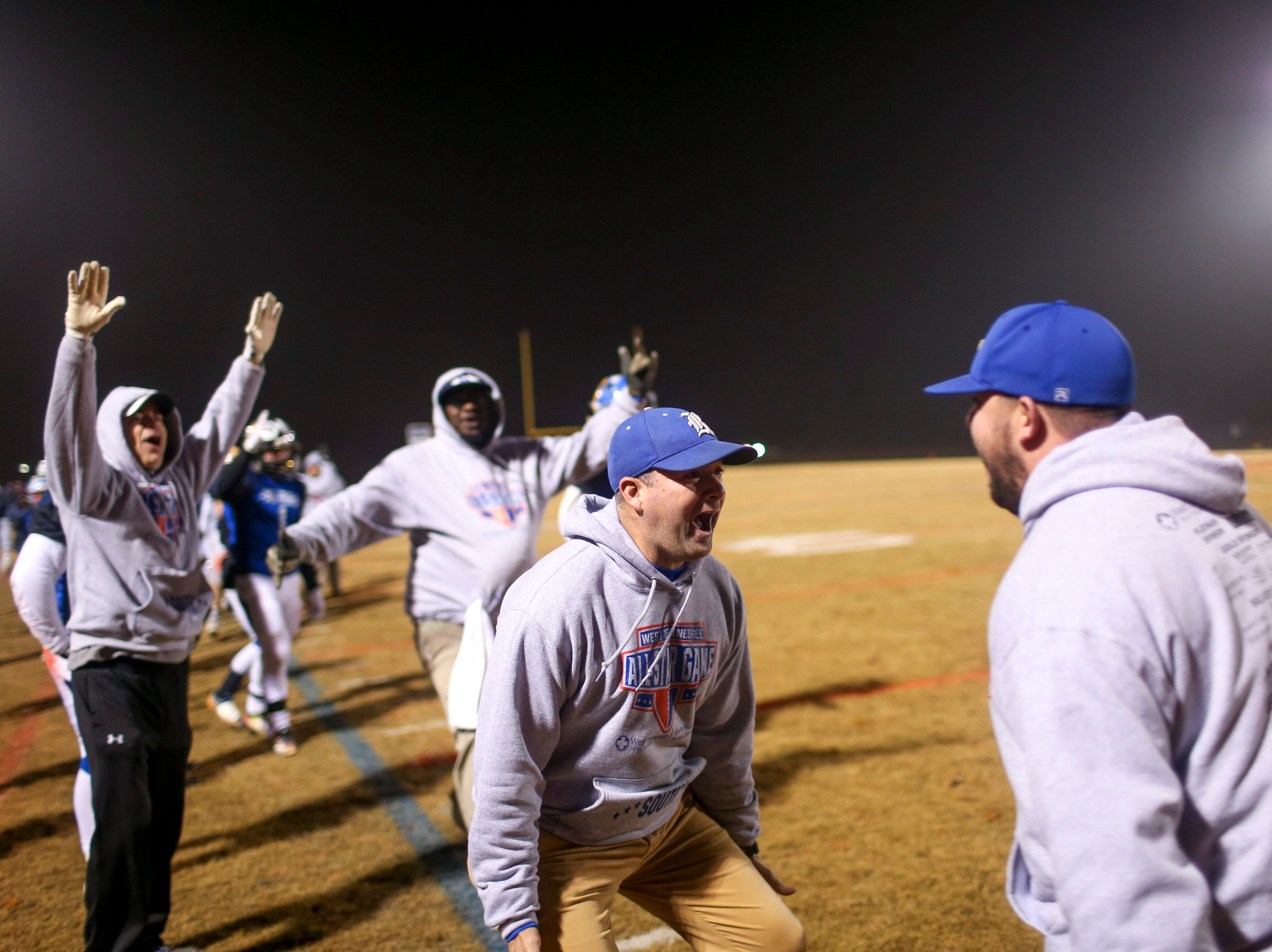South's coaching staff look towards one another and celebrate a pick-six during the West Tennessee All-Star football game at University School of Jackson in Jackson, Tenn., on Friday, Dec. 7, 2018.