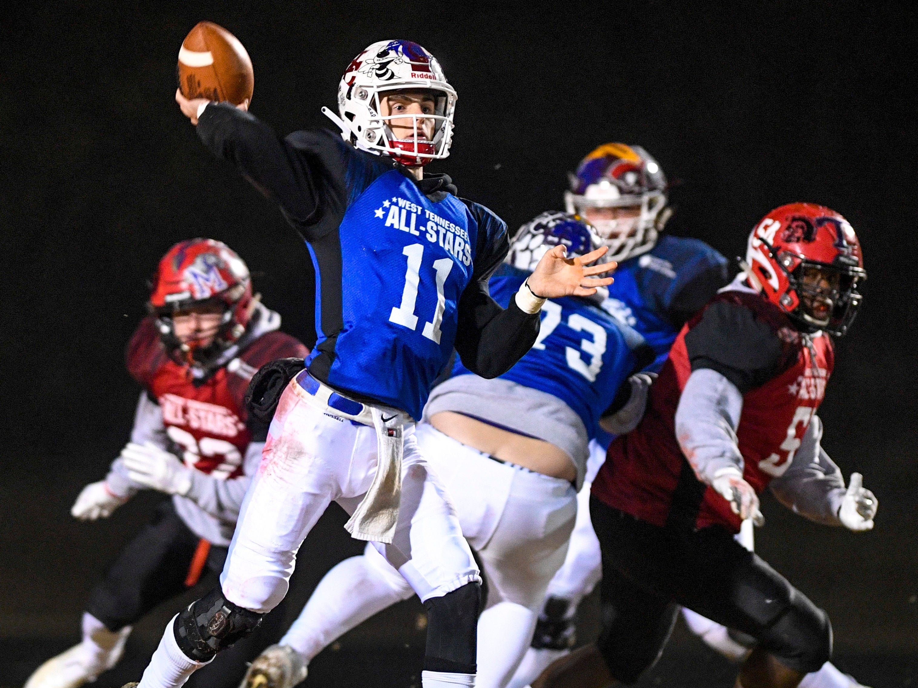 Henry Co's Will Parrish (11) looks to make a pass during the West Tennessee All-Star football game at University School of Jackson in Jackson, Tenn., on Friday, Dec. 7, 2018.