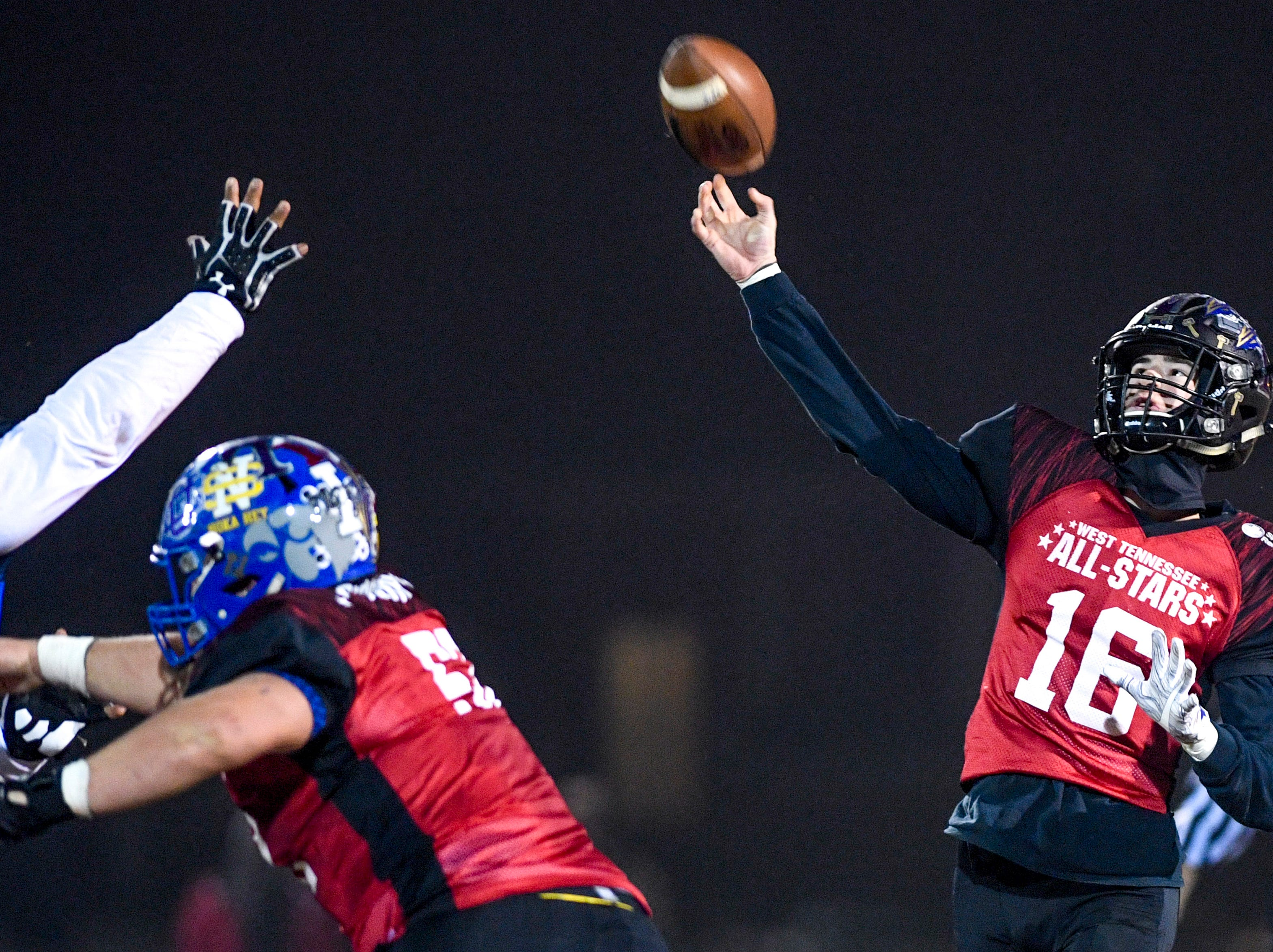 TCA's Lane Lambert (16) lets off a pass during the West Tennessee All-Star football game at University School of Jackson in Jackson, Tenn., on Friday, Dec. 7, 2018.