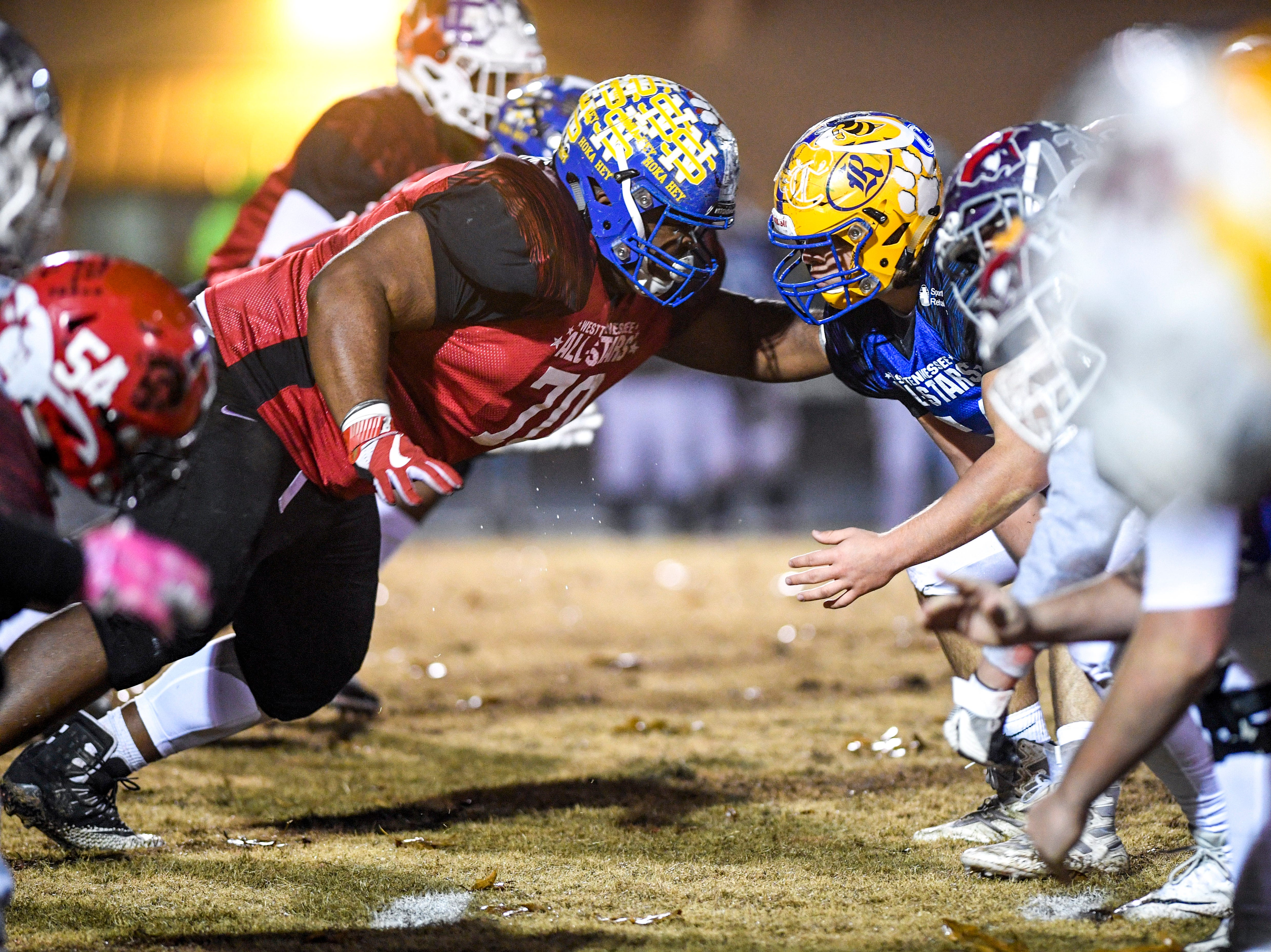 West Tennessee's best football players impact one another at the start of a play during the West Tennessee All-Star football game at University School of Jackson in Jackson, Tenn., on Friday, Dec. 7, 2018.