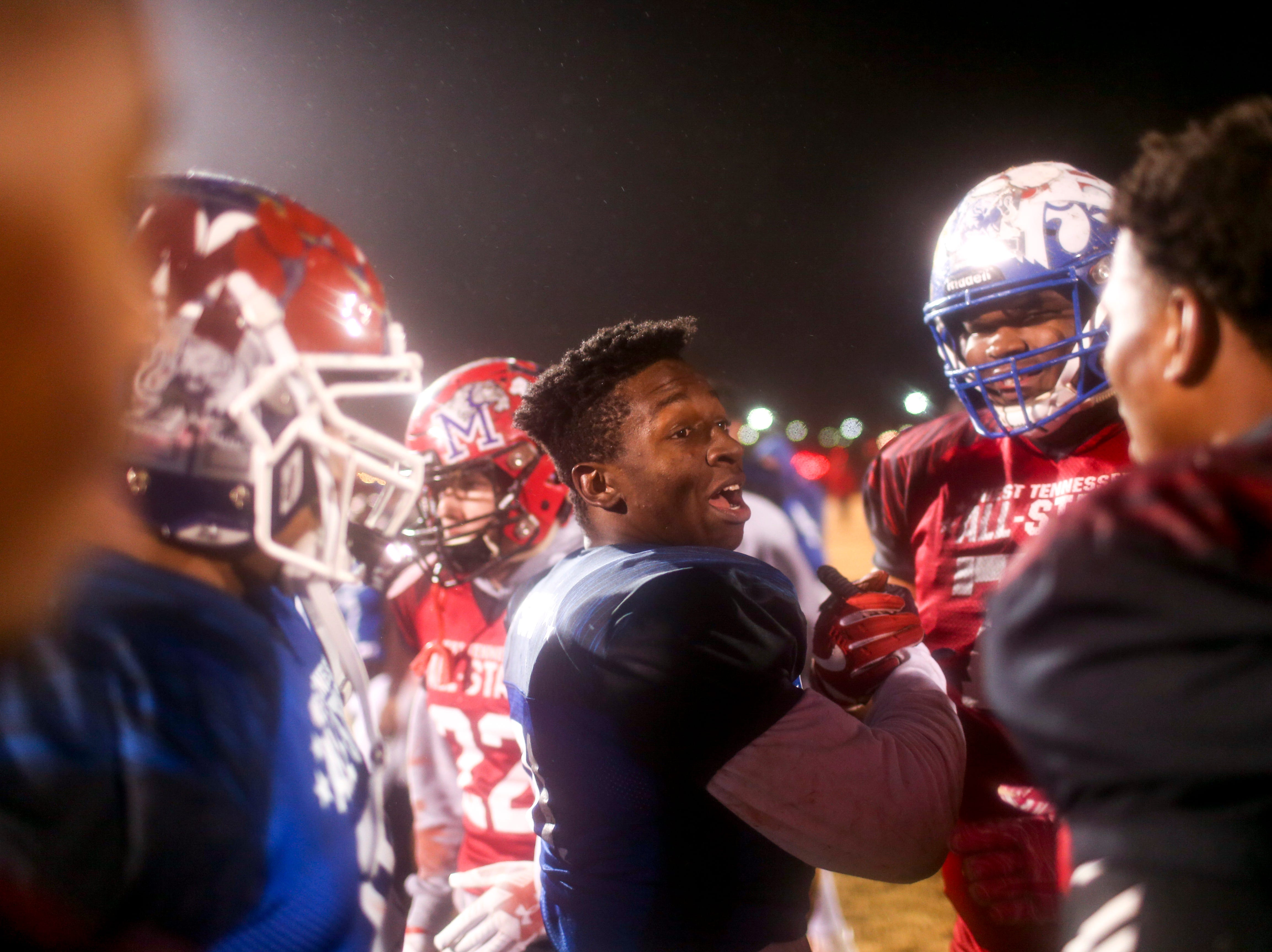 Haywood's Decourtney Reed (31) shakes hands and mingles with other players after  the West Tennessee All-Star football game at University School of Jackson in Jackson, Tenn., on Friday, Dec. 7, 2018.