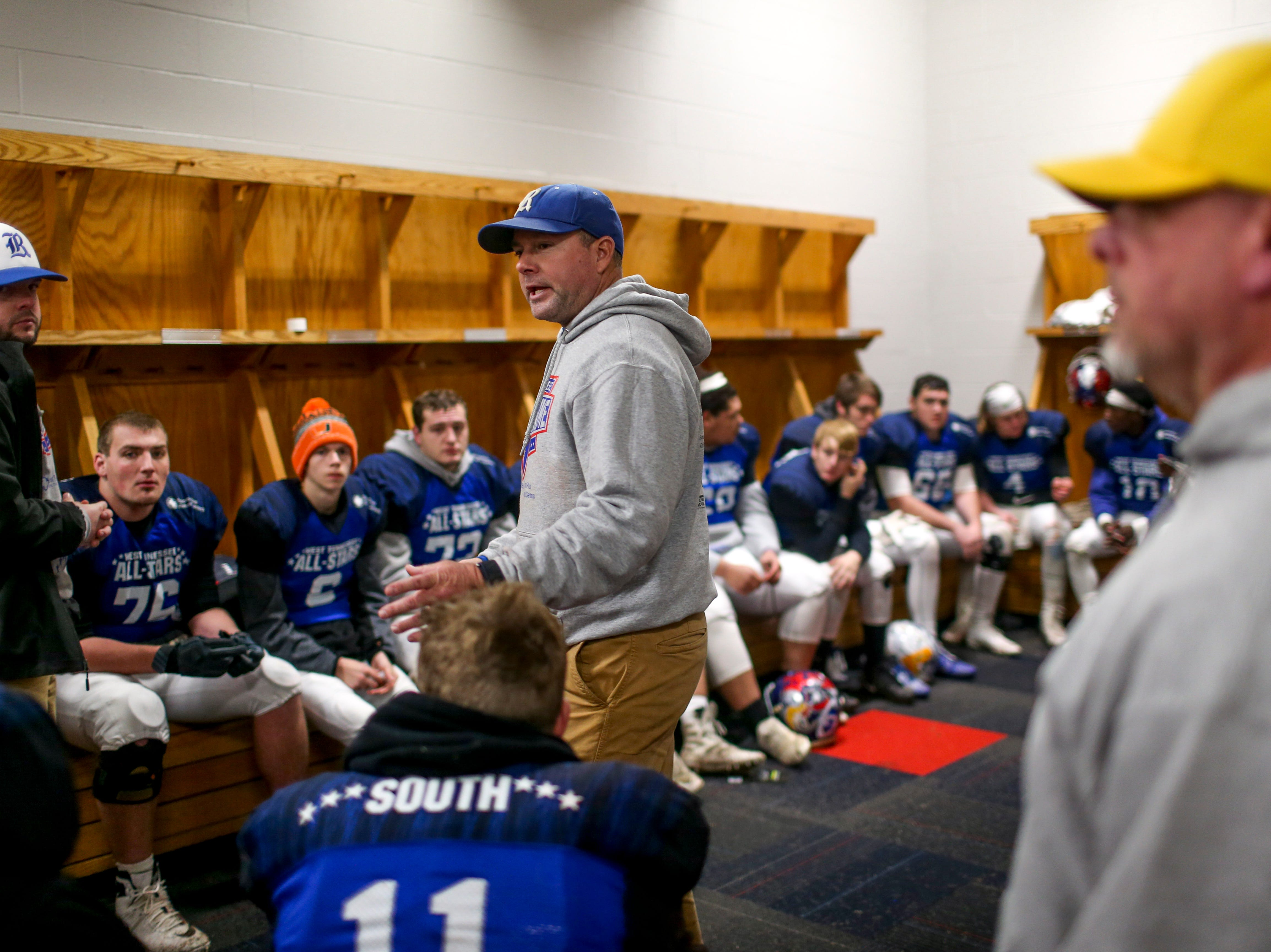 South players discuss strategy at half time during the West Tennessee All-Star football game at University School of Jackson in Jackson, Tenn., on Friday, Dec. 7, 2018.
