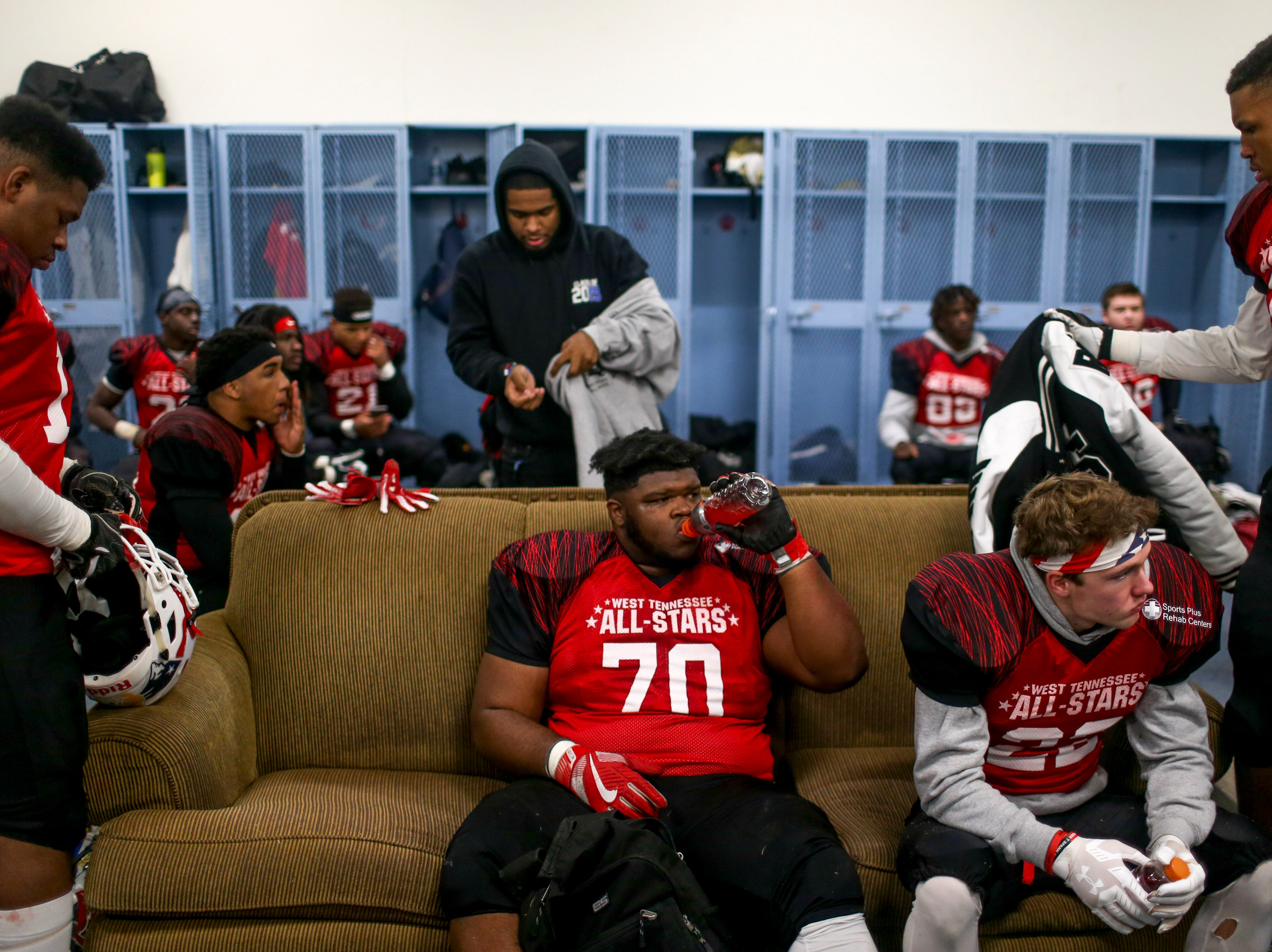 North players hang out in the locker room at half time during the West Tennessee All-Star football game at University School of Jackson in Jackson, Tenn., on Friday, Dec. 7, 2018.
