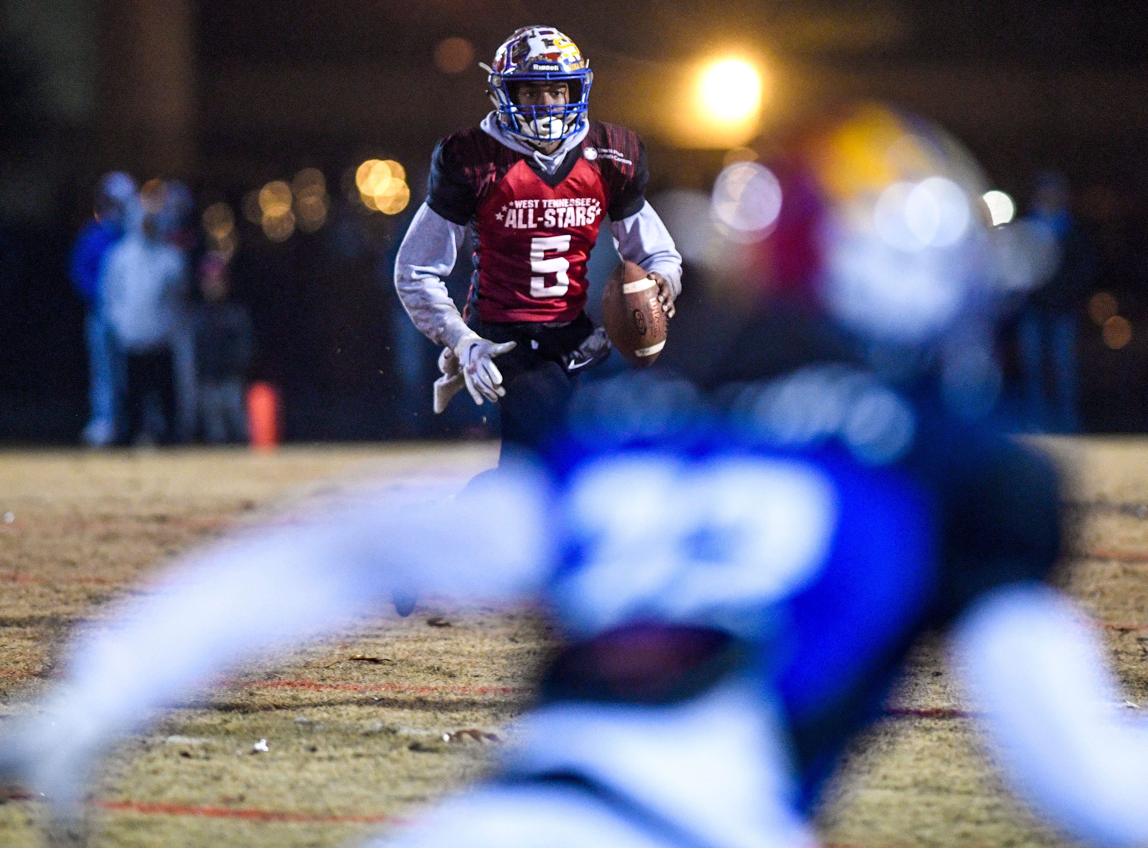North Side's Kameron Farrington (5) looks down the field for a path through the defense during the West Tennessee All-Star football game at University School of Jackson in Jackson, Tenn., on Friday, Dec. 7, 2018.