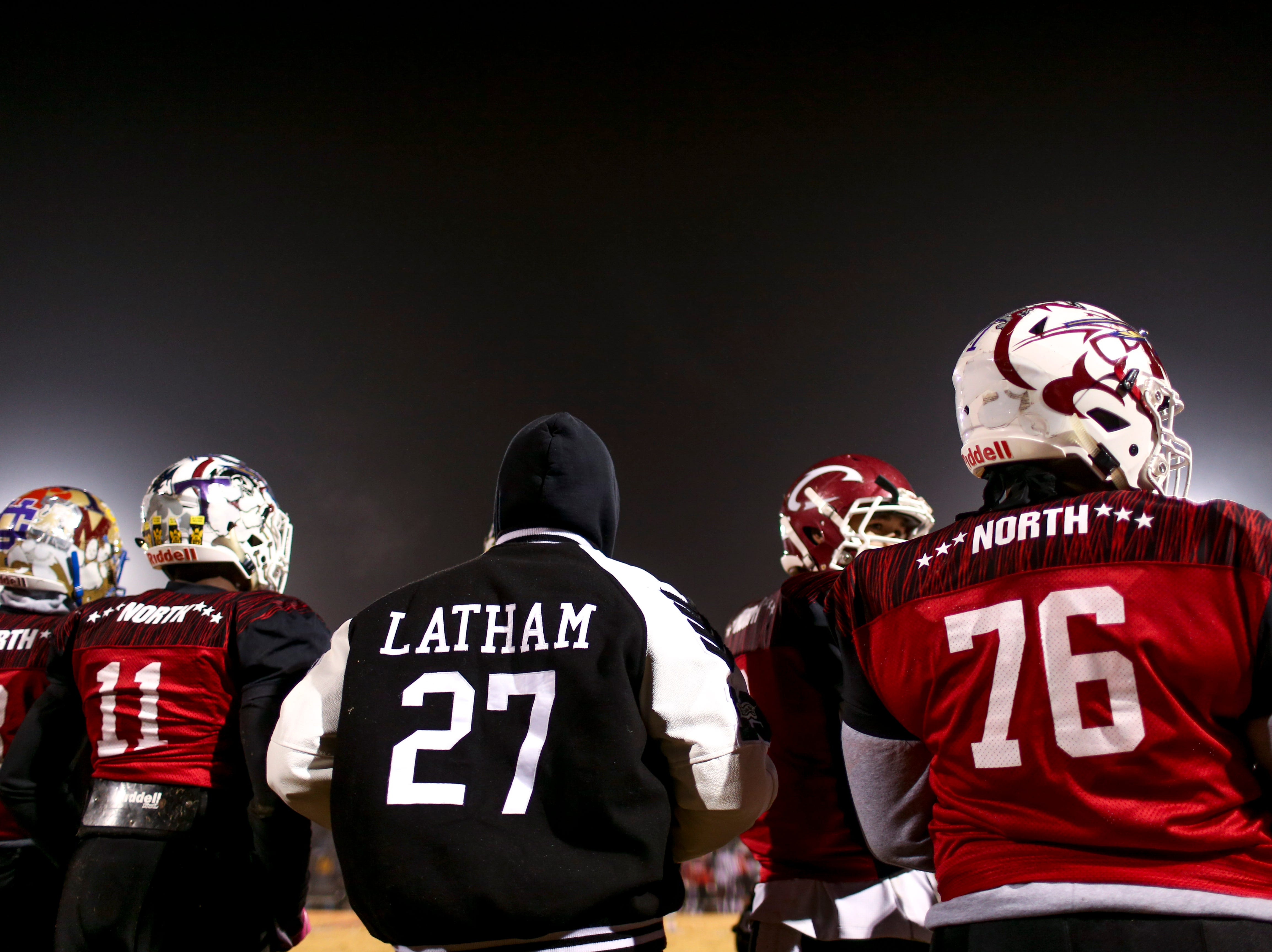 South Side's Eric Latham (27) hangs out on the sidelines, still recovering from a broken collar bone, watching his teammates play their last game during the West Tennessee All-Star football game at University School of Jackson in Jackson, Tenn., on Friday, Dec. 7, 2018.