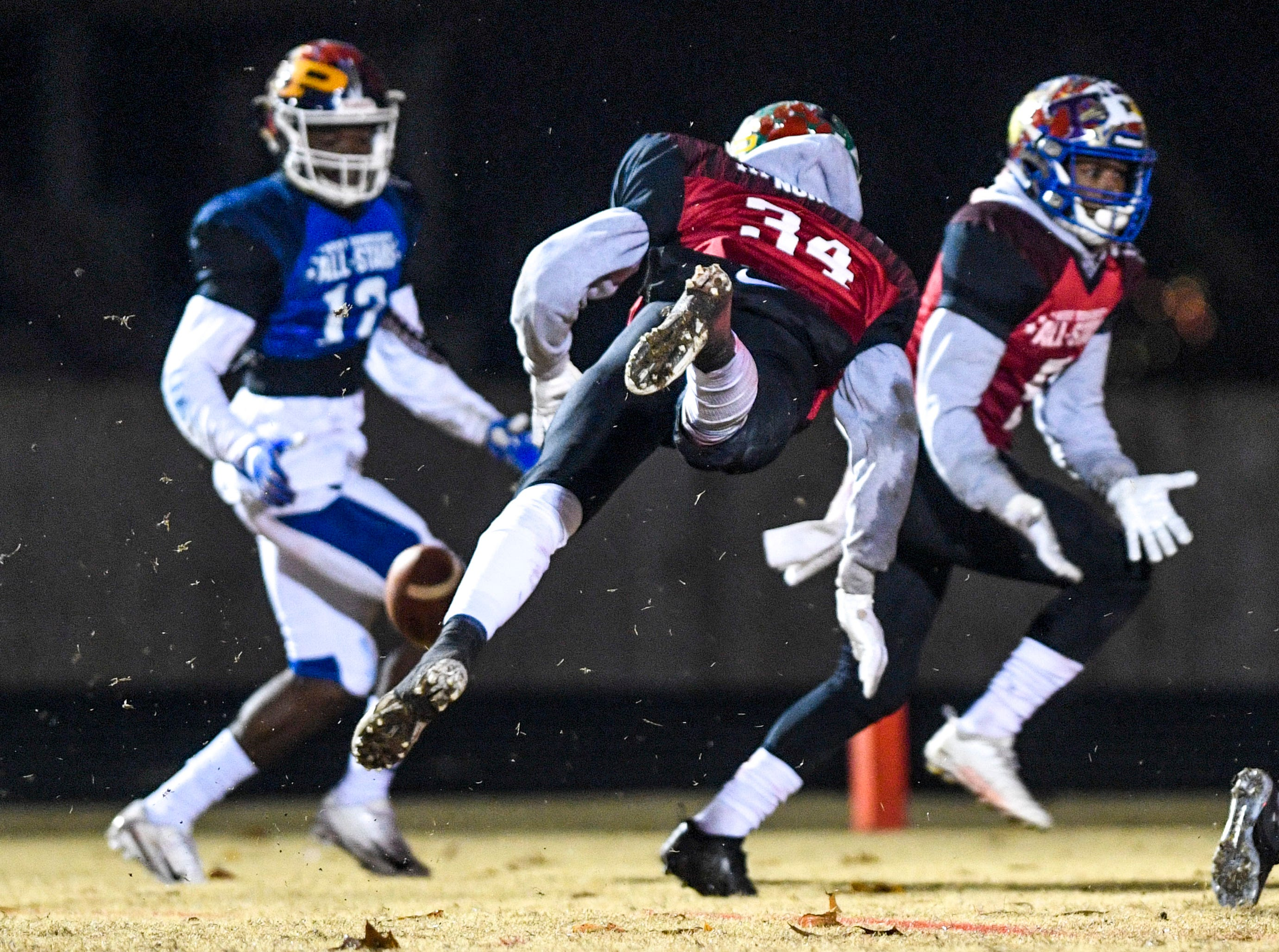 Bolivar's CJ McMahan (34) leaps out to block a pass during the West Tennessee All-Star football game at University School of Jackson in Jackson, Tenn., on Friday, Dec. 7, 2018.
