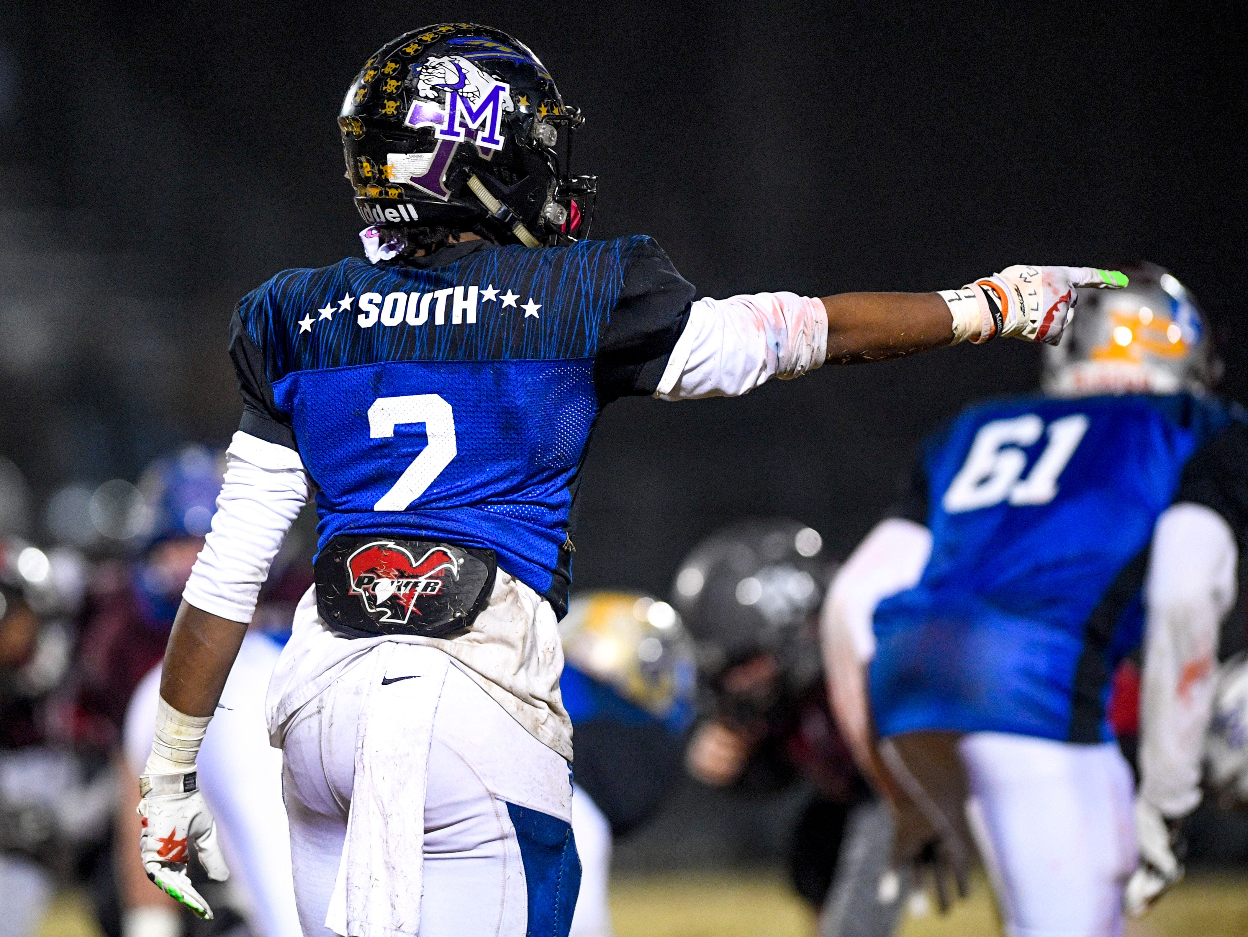 """Peabody's Courtlen Wade (2) points to an opposing player and yells """"He's scared"""" to intimidate them during the West Tennessee All-Star football game at University School of Jackson in Jackson, Tenn., on Friday, Dec. 7, 2018."""