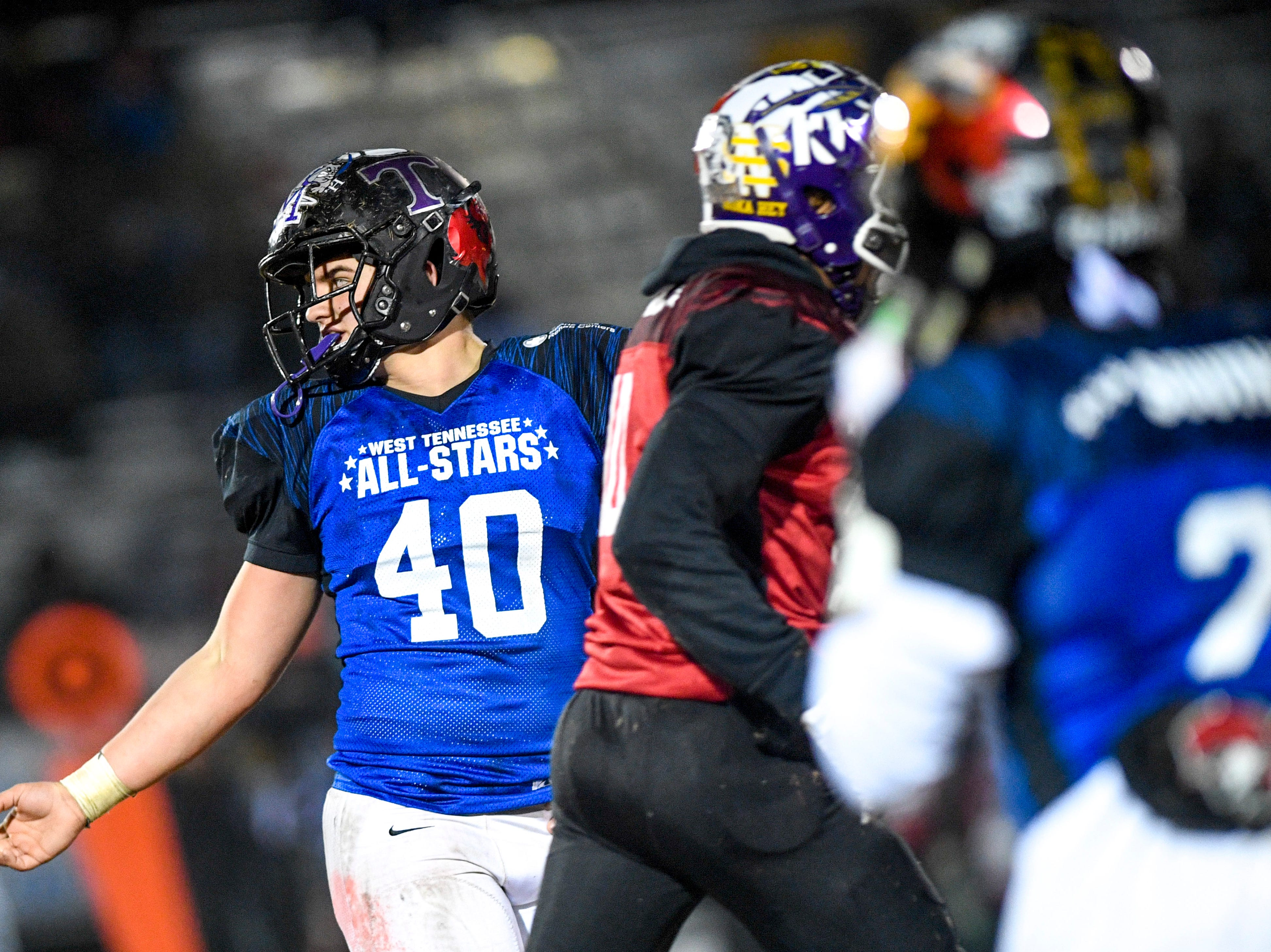 TCA's Addison Coleman (40) looks back to jokingly taunt another player during the West Tennessee All-Star football game at University School of Jackson in Jackson, Tenn., on Friday, Dec. 7, 2018.