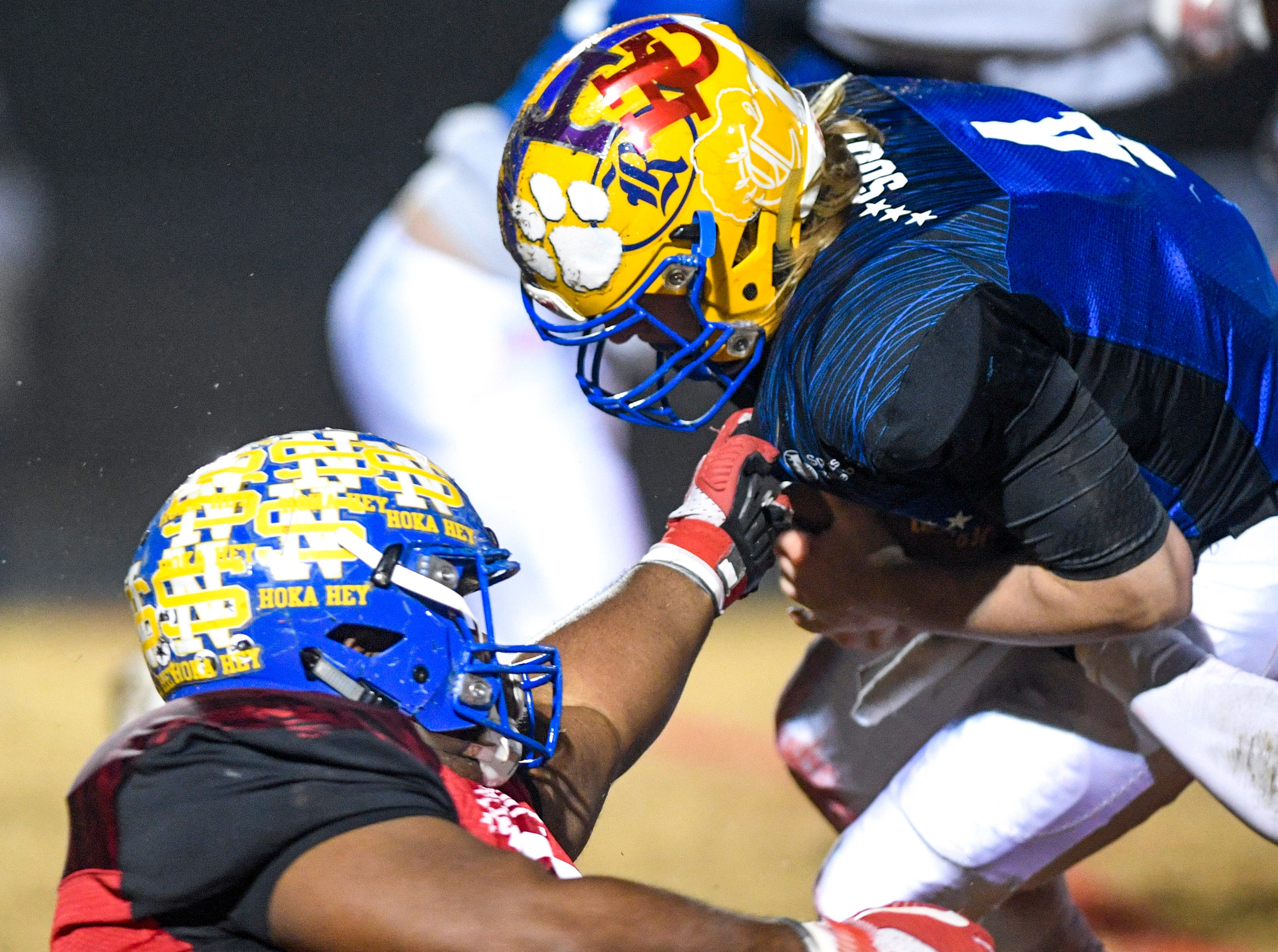 North Side's Kevin Albea II (70) grabs and helps tackle Riverside's Stone Frost (4) during the West Tennessee All-Star football game at University School of Jackson in Jackson, Tenn., on Friday, Dec. 7, 2018.