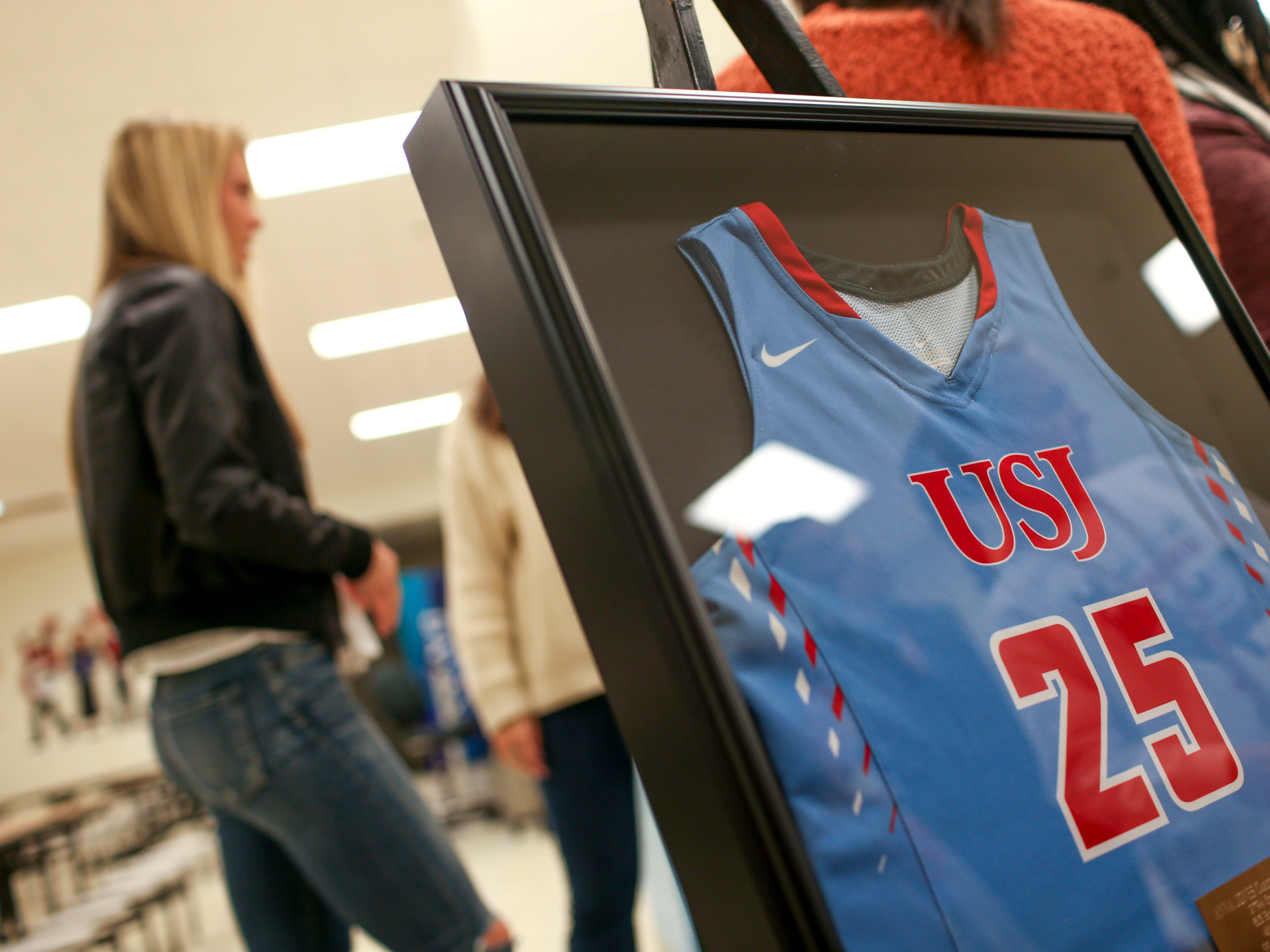 A framed number 25 jersey was presented to Anna Jones during the retirement ceremony of the number at University School of Jackson in Jackson, Tenn., on Friday, Dec. 7, 2018.
