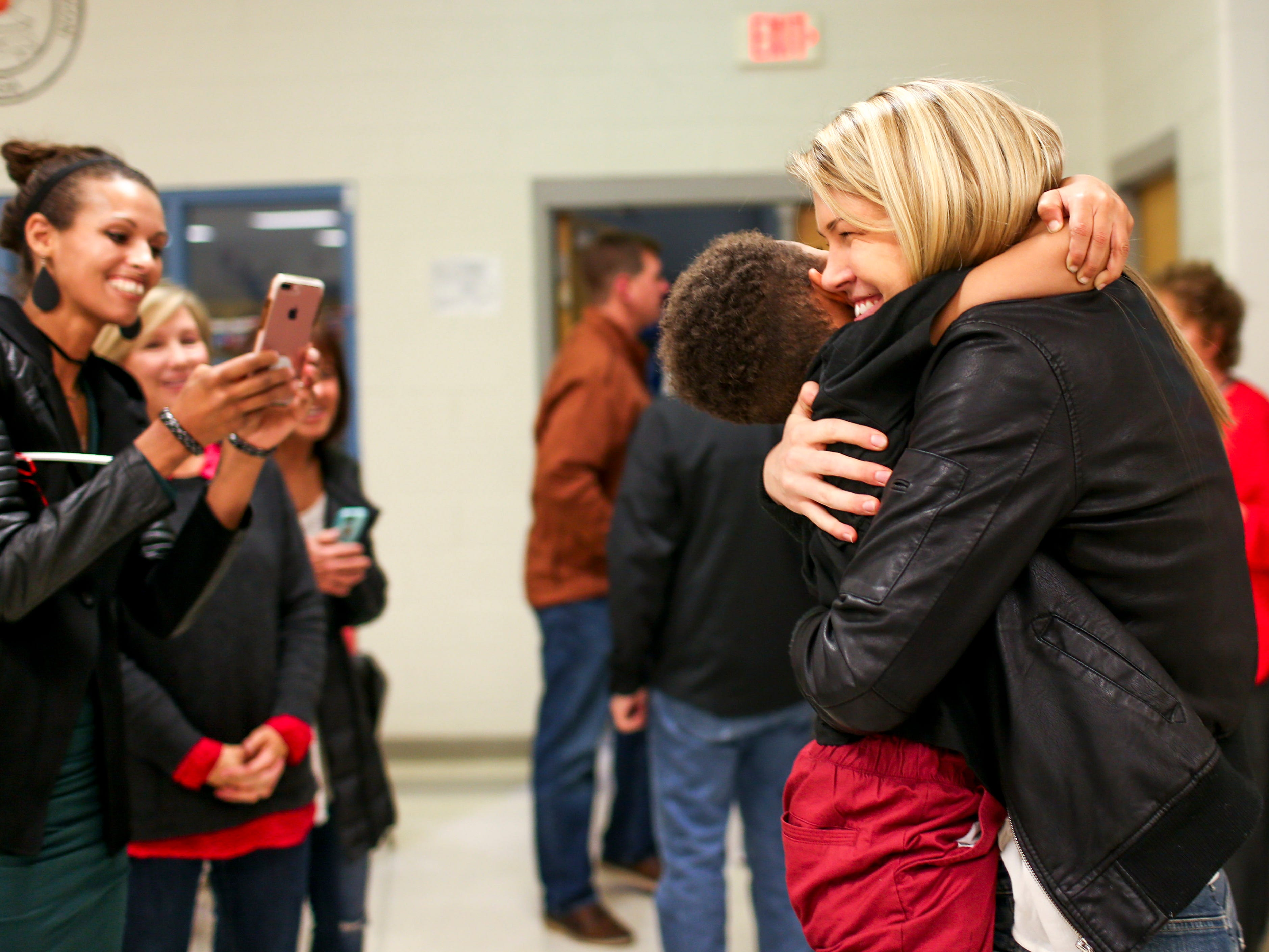 Anna Jones embraces her head coach's son Zavior Schutes during the jersey number 25 retirement at University School of Jackson in Jackson, Tenn., on Friday, Dec. 7, 2018.