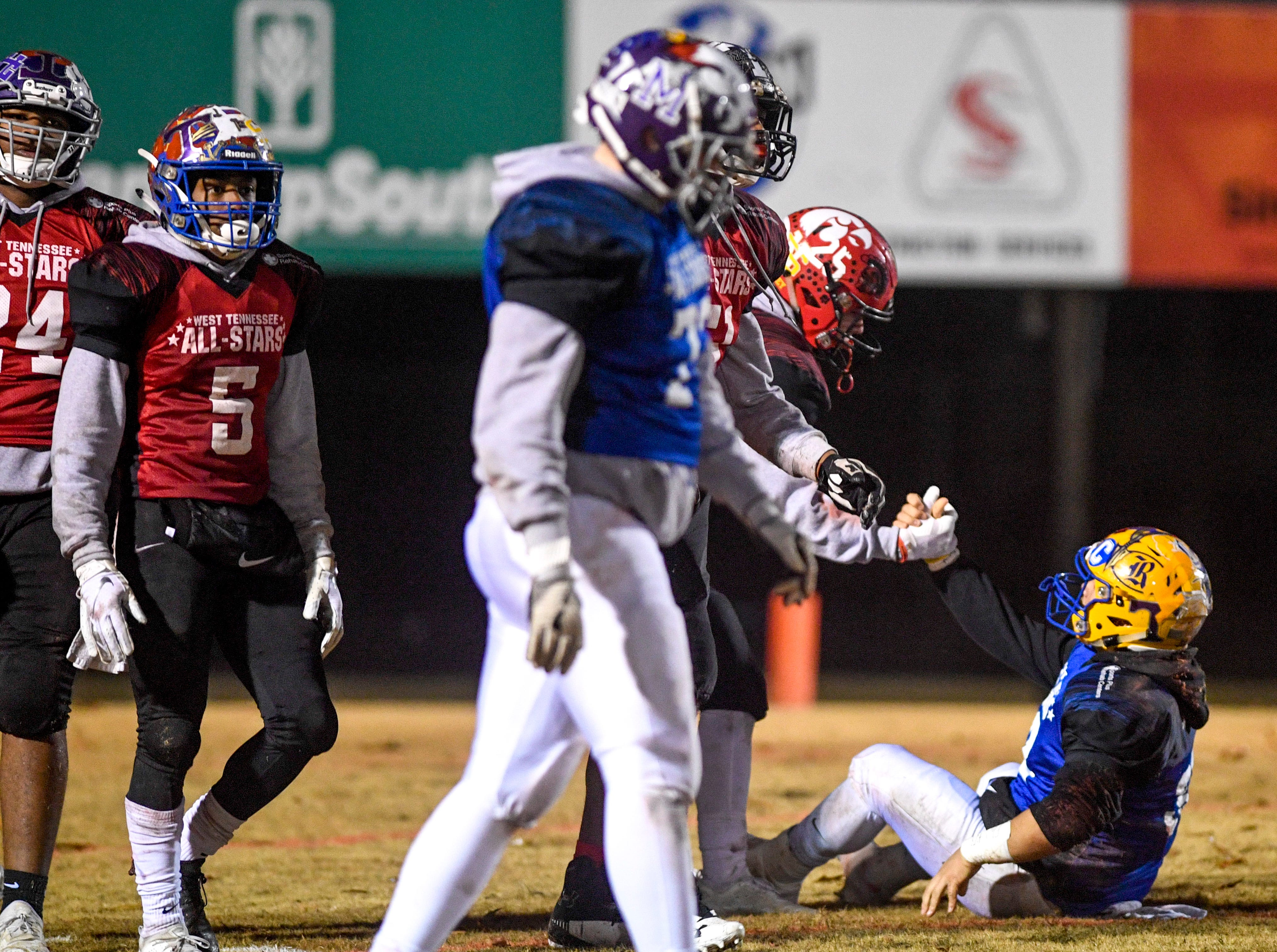 Players help up Riverside's Mason Montgomery (54) during the West Tennessee All-Star football game at University School of Jackson in Jackson, Tenn., on Friday, Dec. 7, 2018.