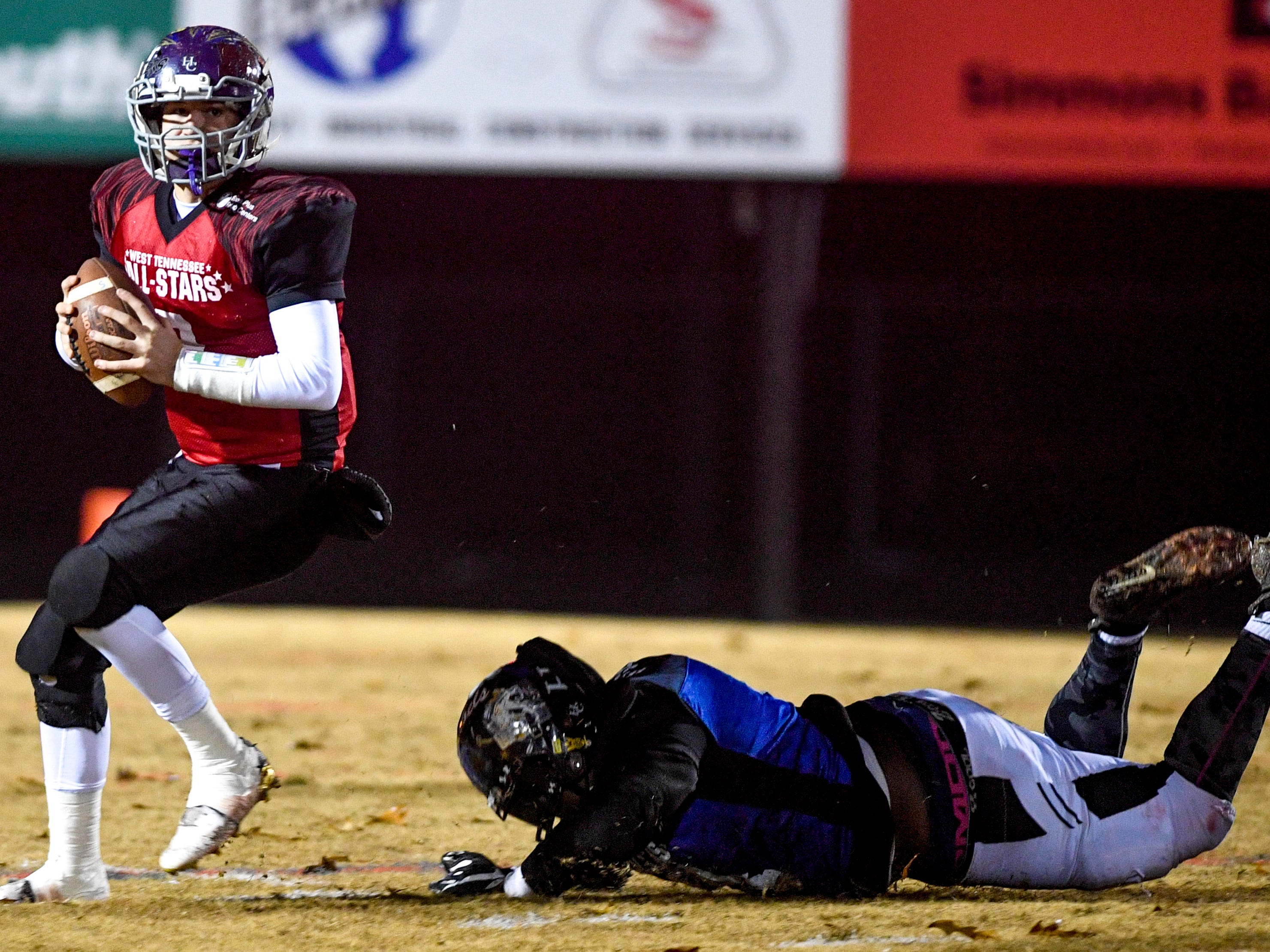 Milan's Taylor Lockhart (9) evades a South player trying to tackle him during the West Tennessee All-Star football game at University School of Jackson in Jackson, Tenn., on Friday, Dec. 7, 2018.