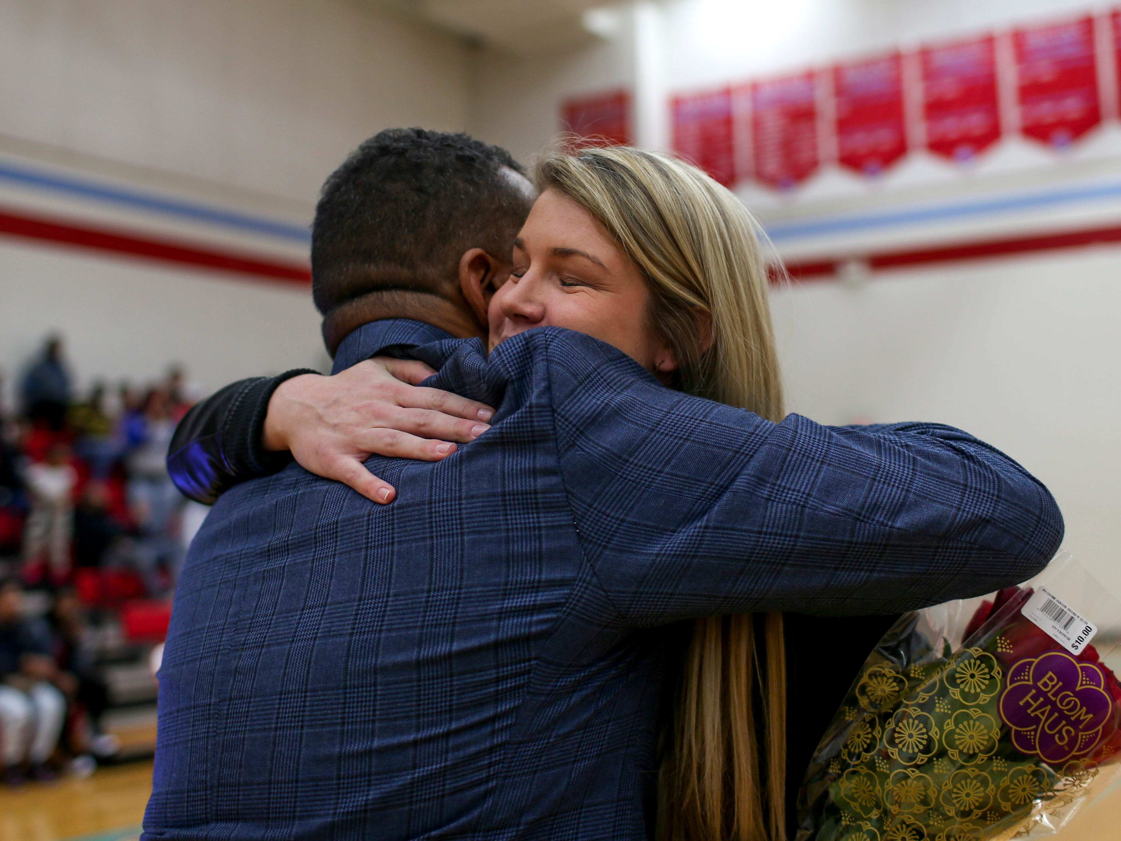USJ basketball coach Tony Shutes embraces former player Anna Jones during the retirement of her old jersey number 25 at University School of Jackson in Jackson, Tenn., on Friday, Dec. 7, 2018.