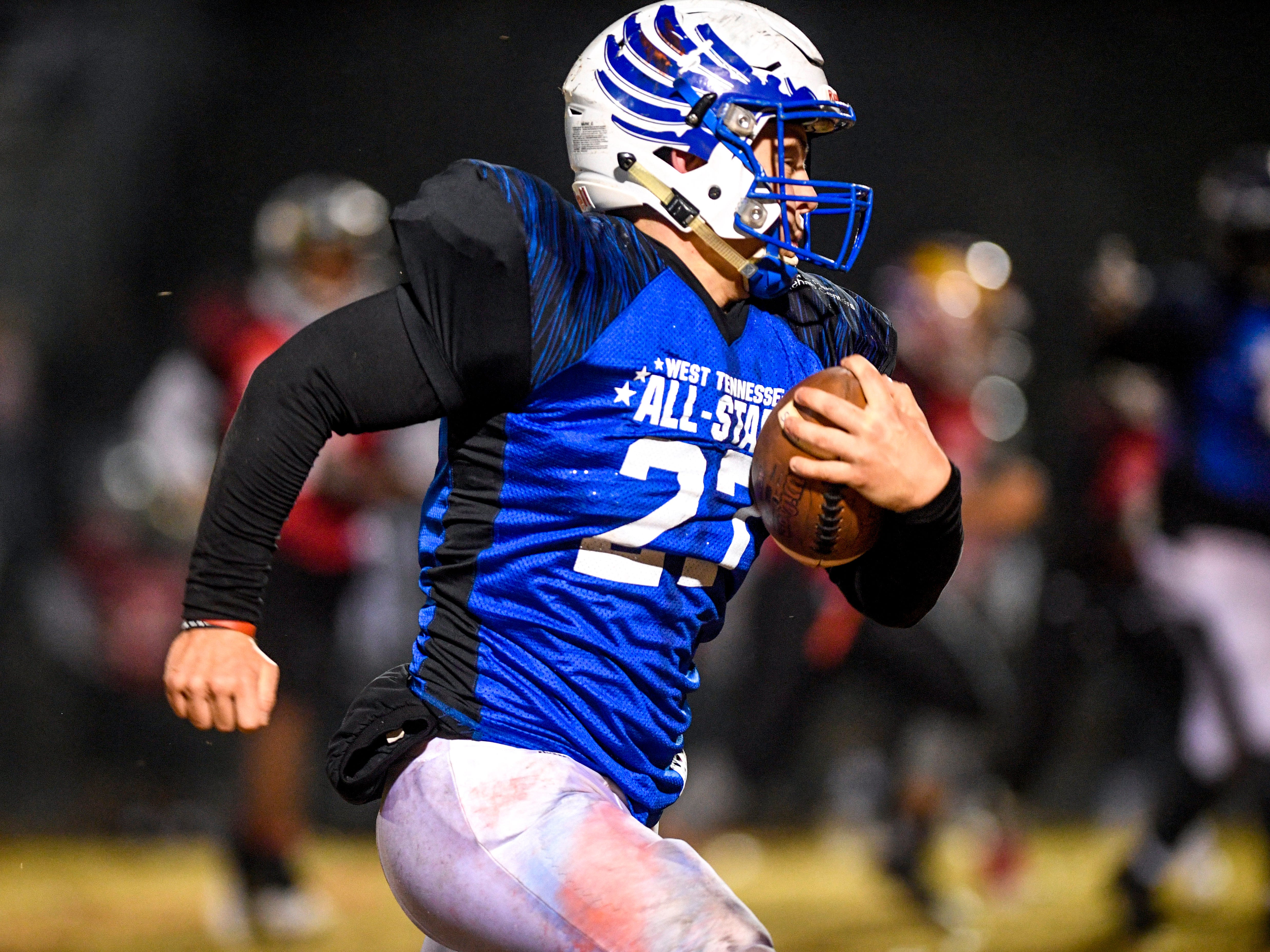 Chester Co's Peyton Doles (27) runs down the field after intercepting a pass, that he would take for a touchdown during the West Tennessee All-Star football game at University School of Jackson in Jackson, Tenn., on Friday, Dec. 7, 2018.