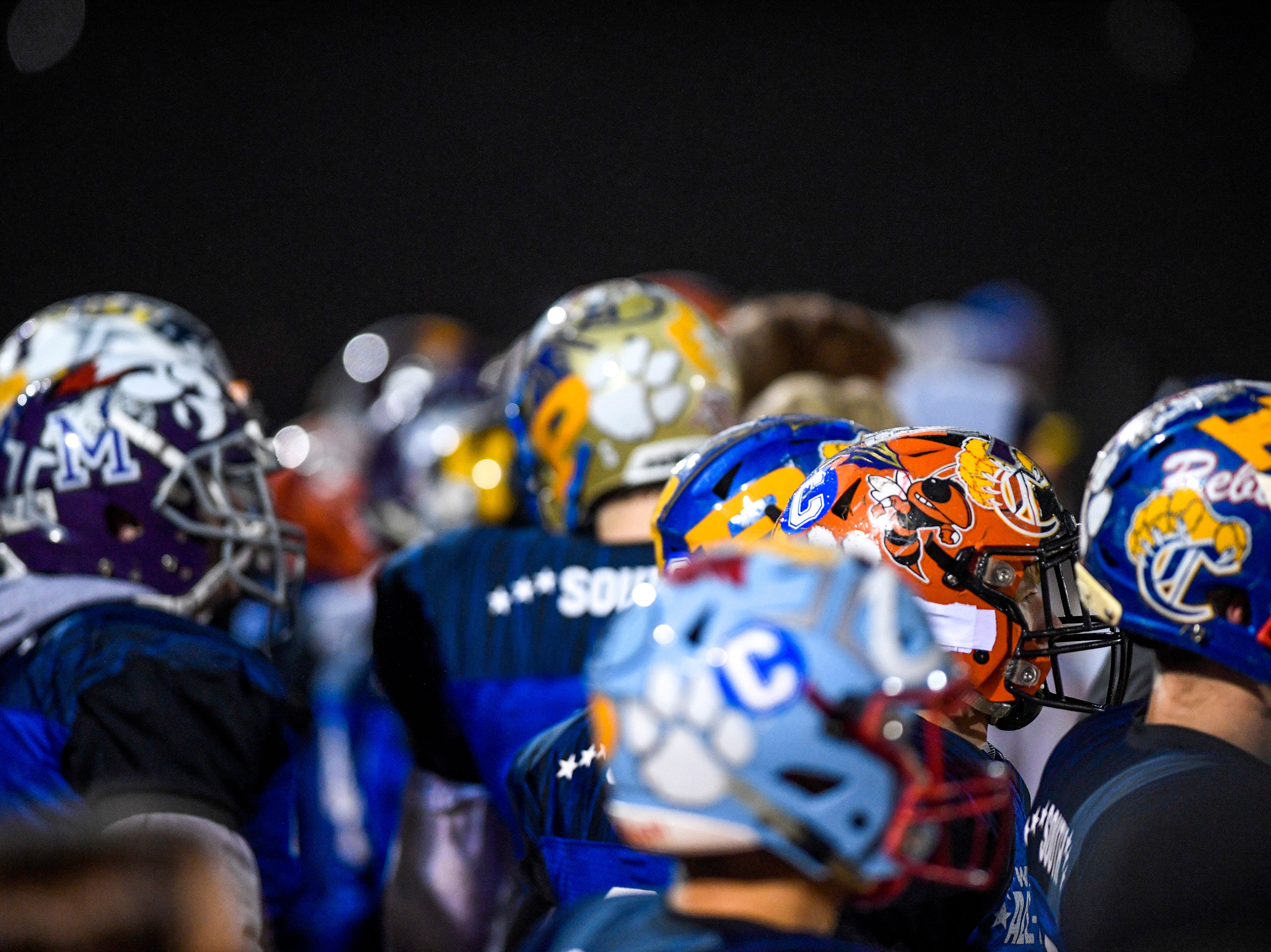 South players mingle on the sidelines during the West Tennessee All-Star football game at University School of Jackson in Jackson, Tenn., on Friday, Dec. 7, 2018.