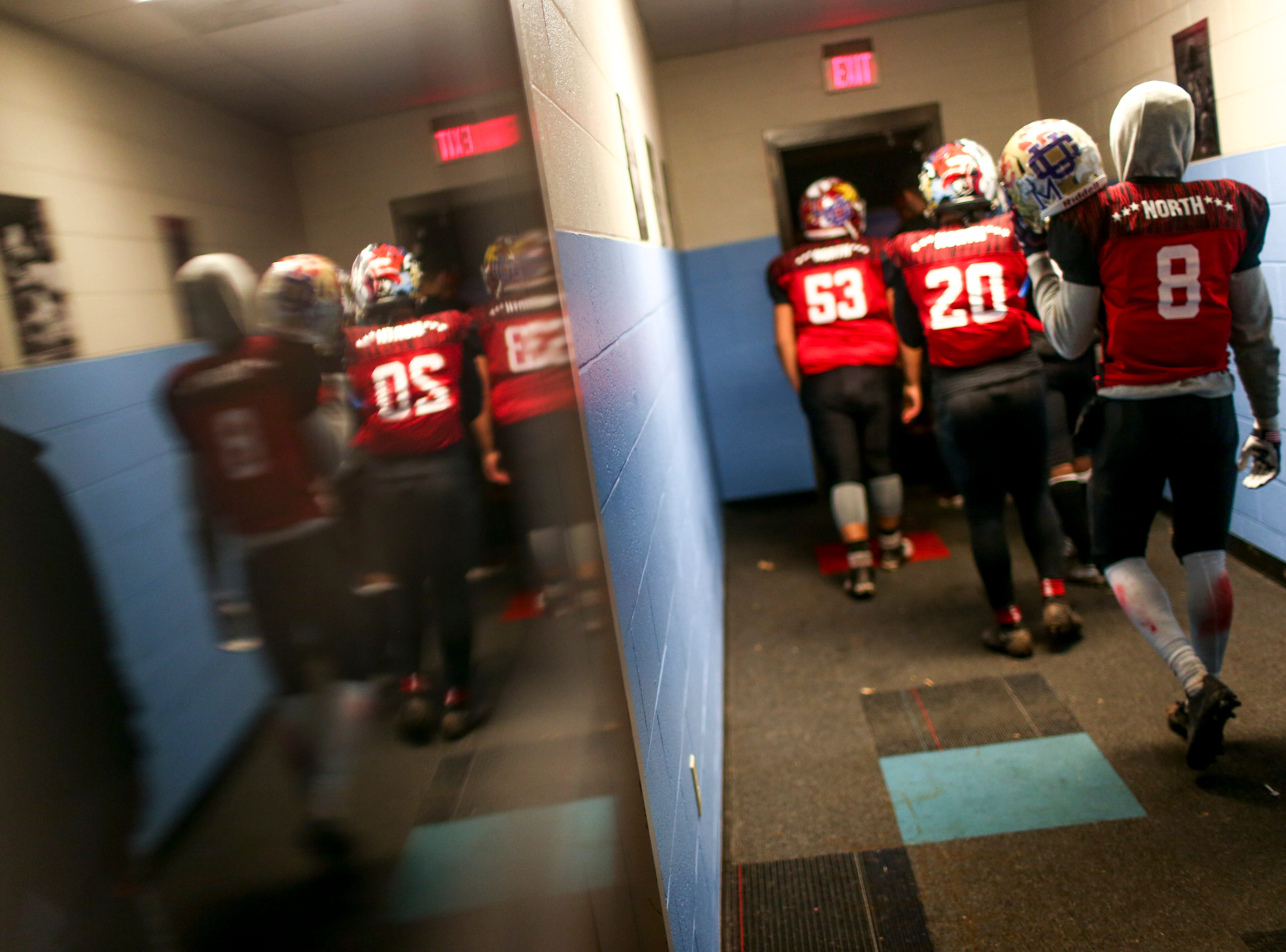 North players walk out of the locker rooms and back to the field from half time during the West Tennessee All-Star football game at University School of Jackson in Jackson, Tenn., on Friday, Dec. 7, 2018.