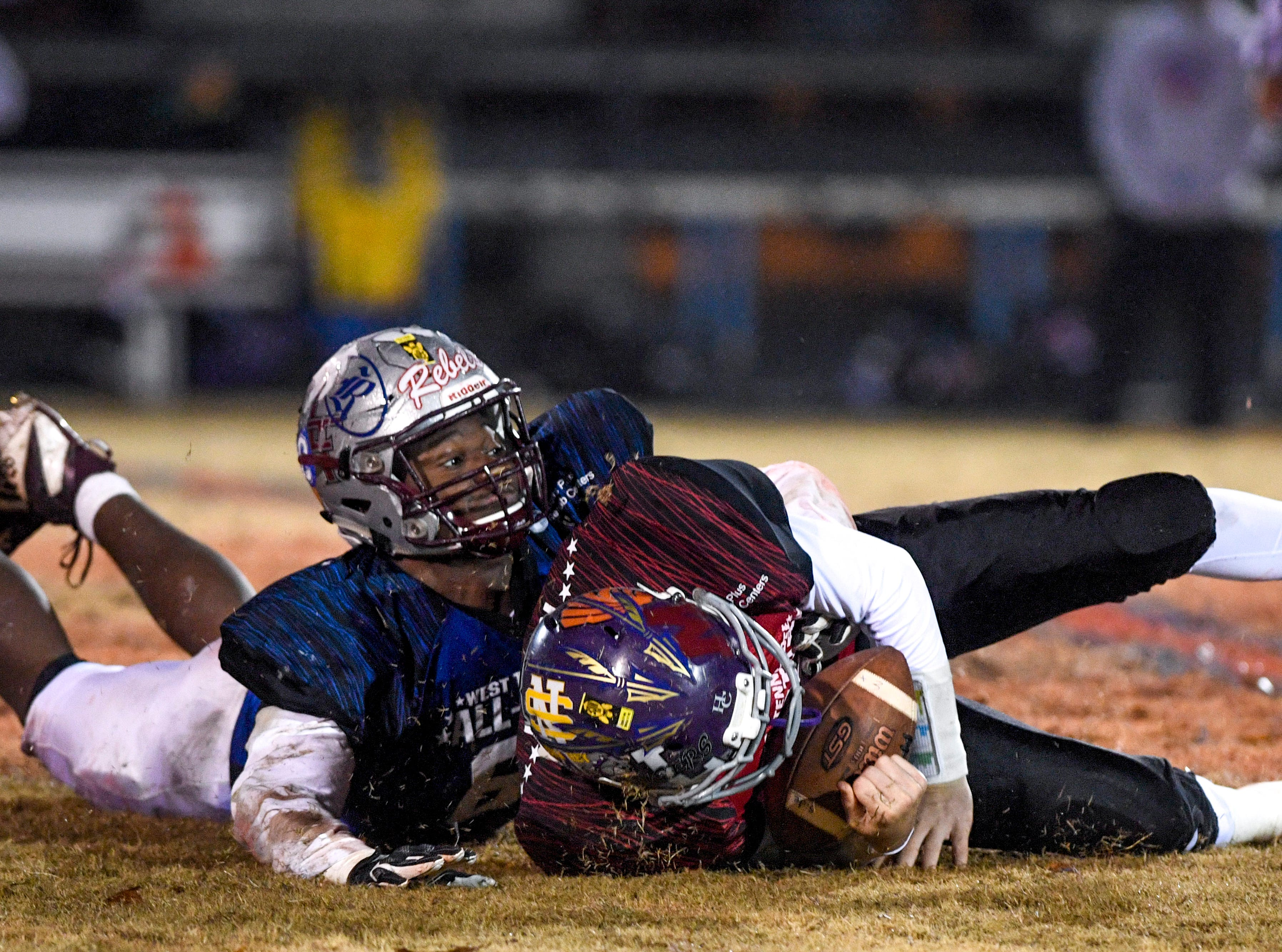 Liberty's Jeremiah Fitzhugh (61) sacks Milan's Taylor Lockhart (9) during the West Tennessee All-Star football game at University School of Jackson in Jackson, Tenn., on Friday, Dec. 7, 2018.