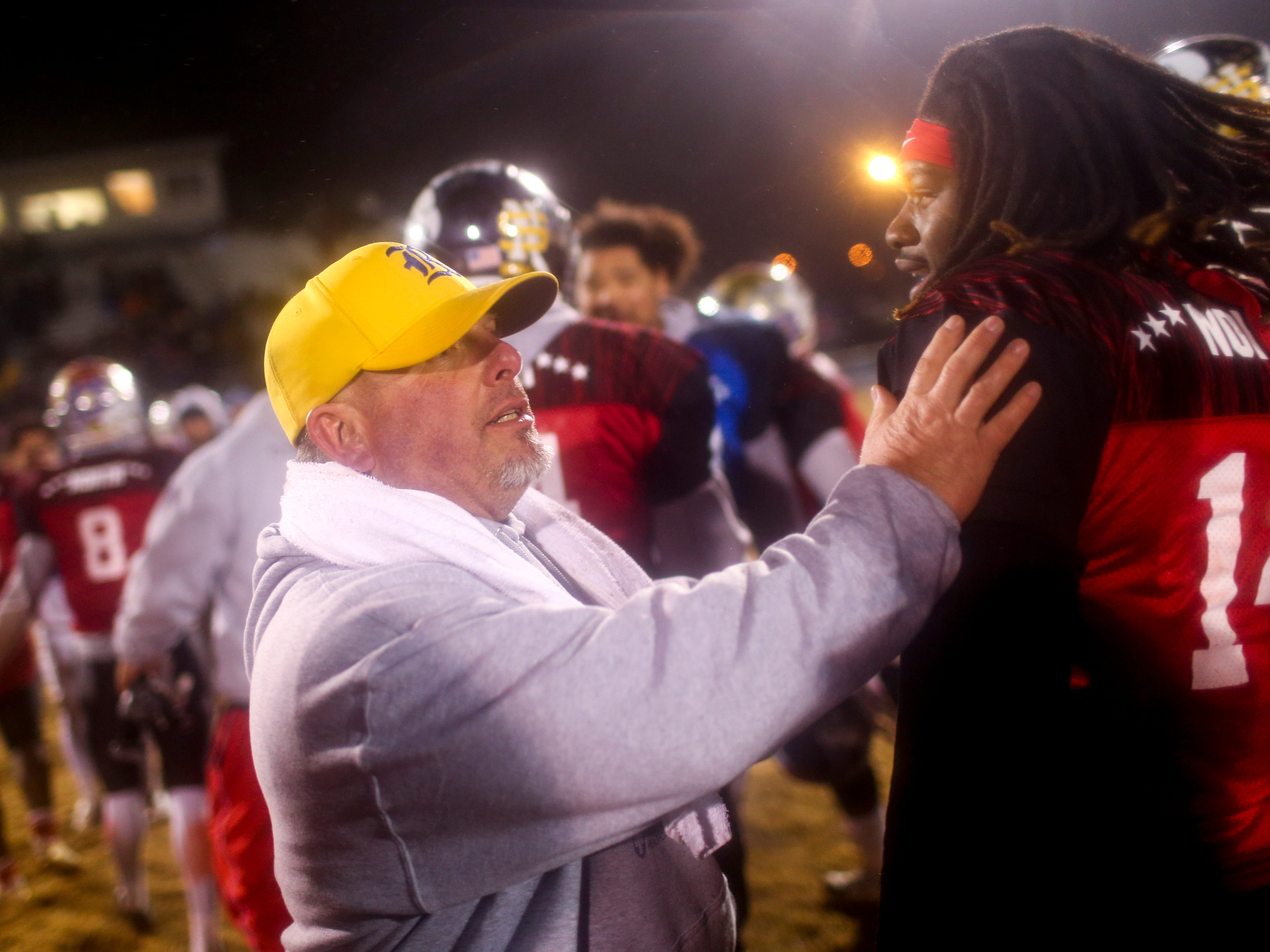 Riverside's head coach Johnnie Frost shakes hands with passing North team players during the West Tennessee All-Star football game at University School of Jackson in Jackson, Tenn., on Friday, Dec. 7, 2018.