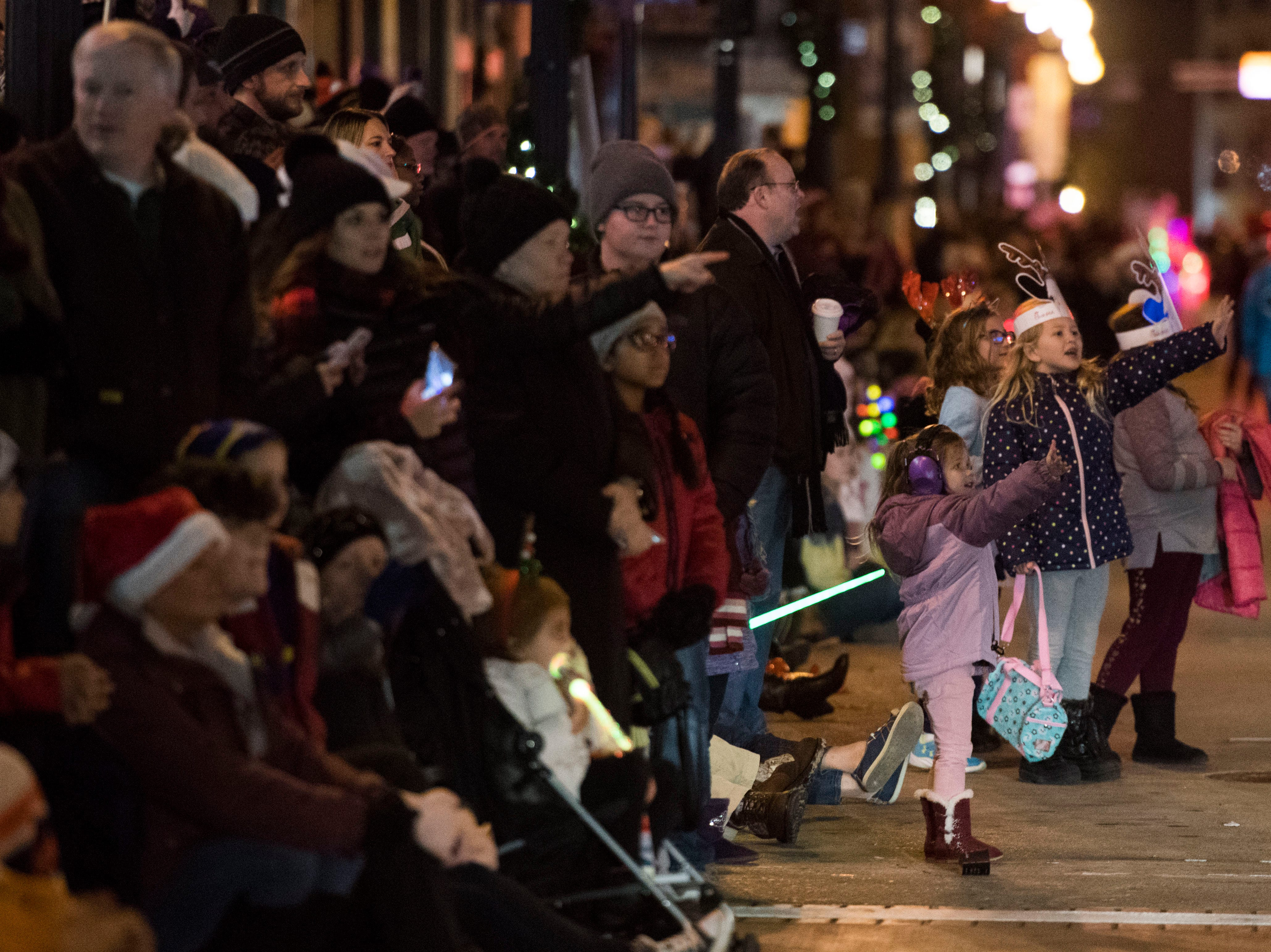 Spectators watch the annual WIVK Christmas Parade in downtown Knoxville Friday, Dec. 7, 2018.