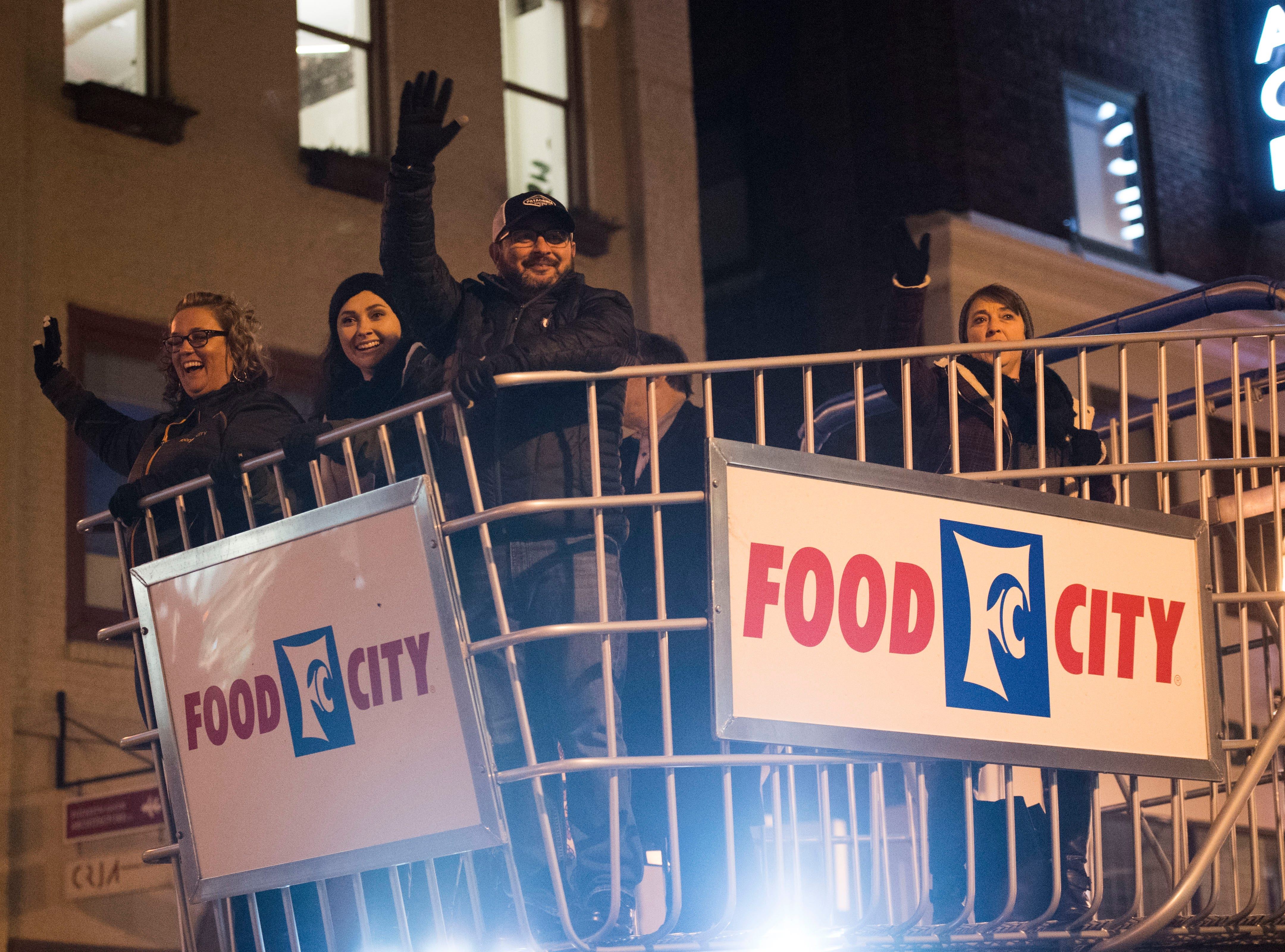 The Food City float drives by during the annual WIVK Christmas Parade in downtown Knoxville Friday, Dec. 7, 2018.