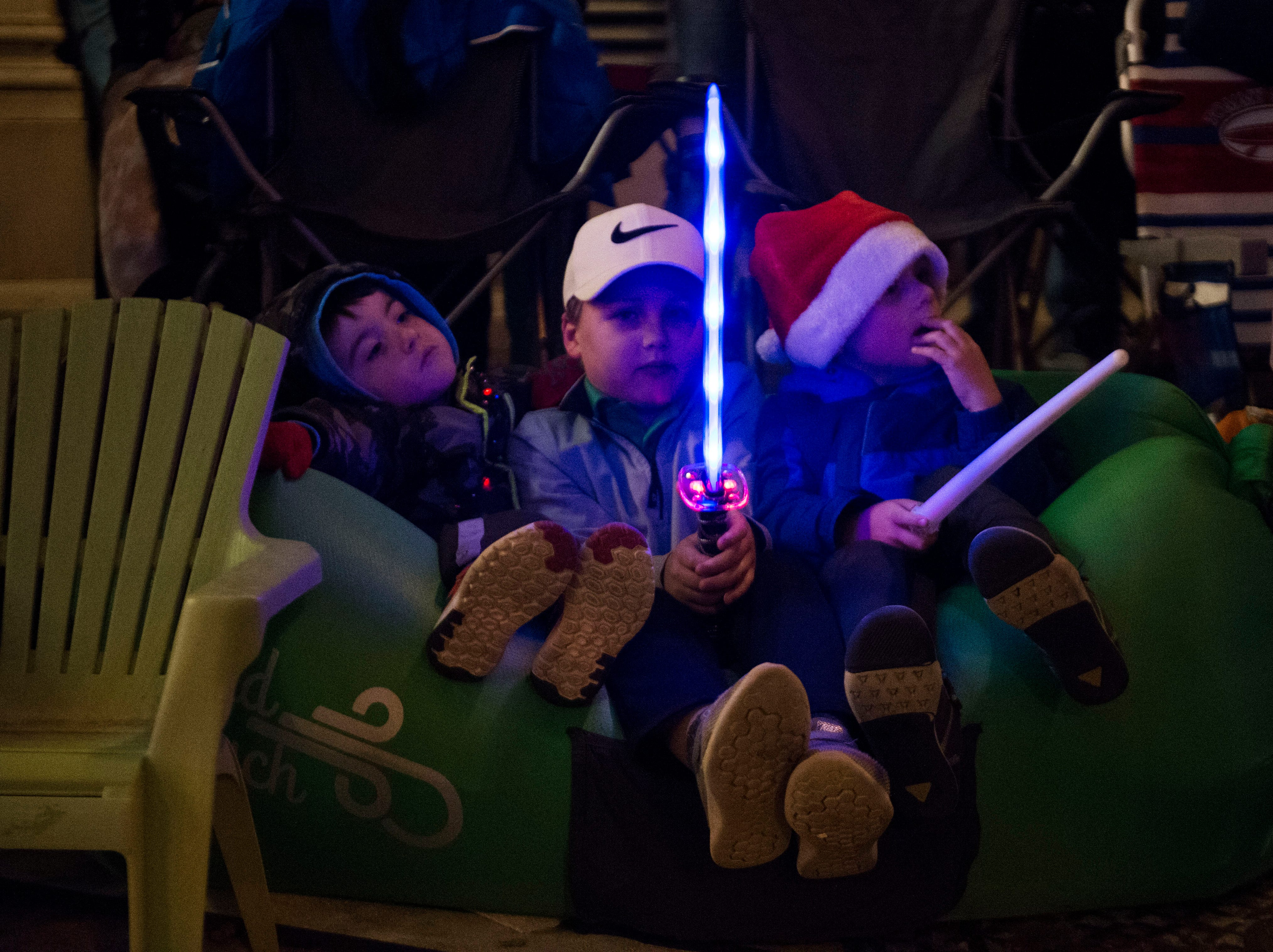 Steele Wright, 5, Xavier Wright, 7 and Cruz Wiles, 5, watch the annual WIVK Christmas Parade in downtown Knoxville Friday, Dec. 7, 2018.