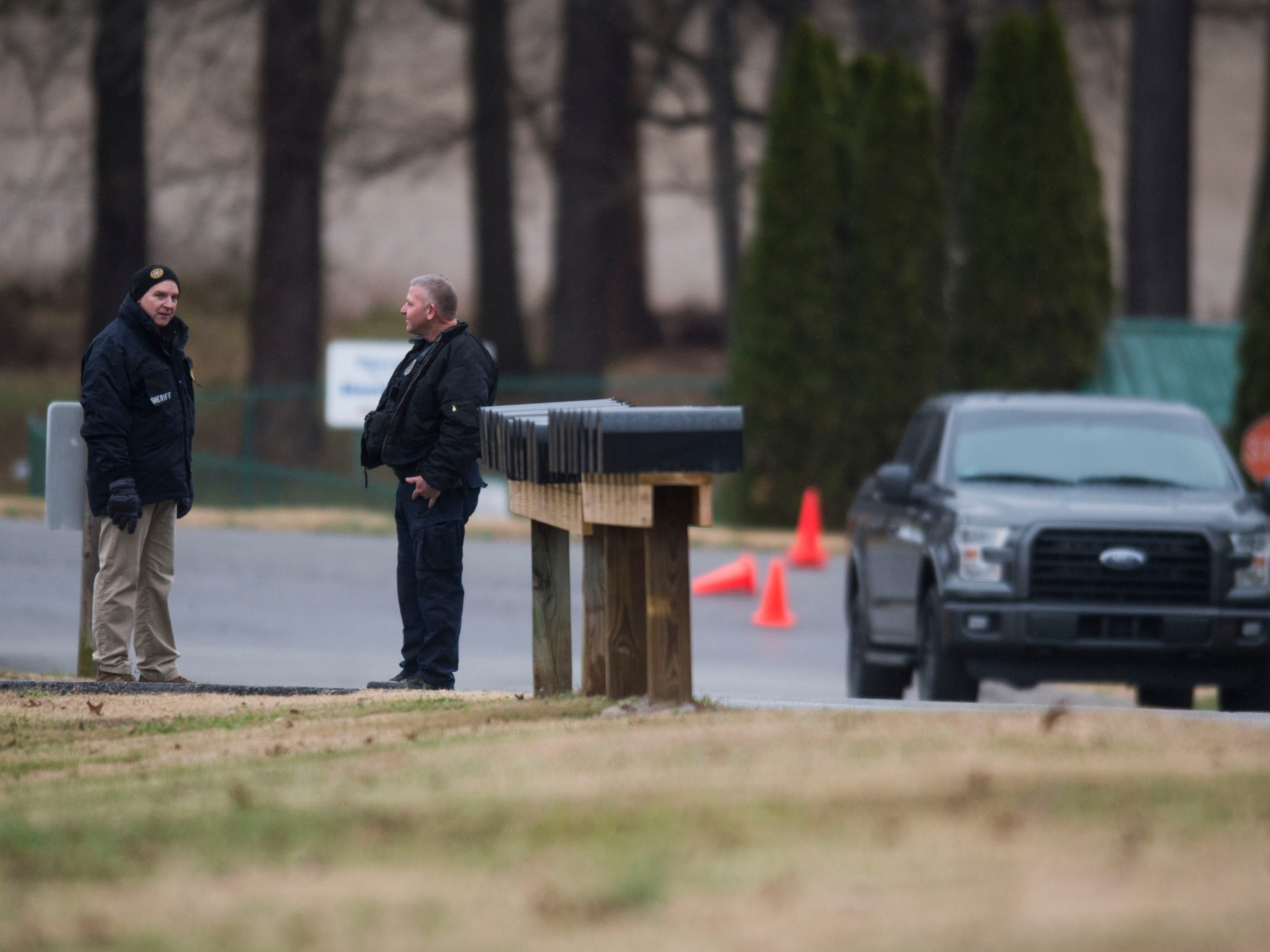 Blount County Sheriff's officers wait outside an apartment building during a standoff involving one person believed to be armed at Riverside Manor Apartments Saturday, Dec. 8, 2018.
