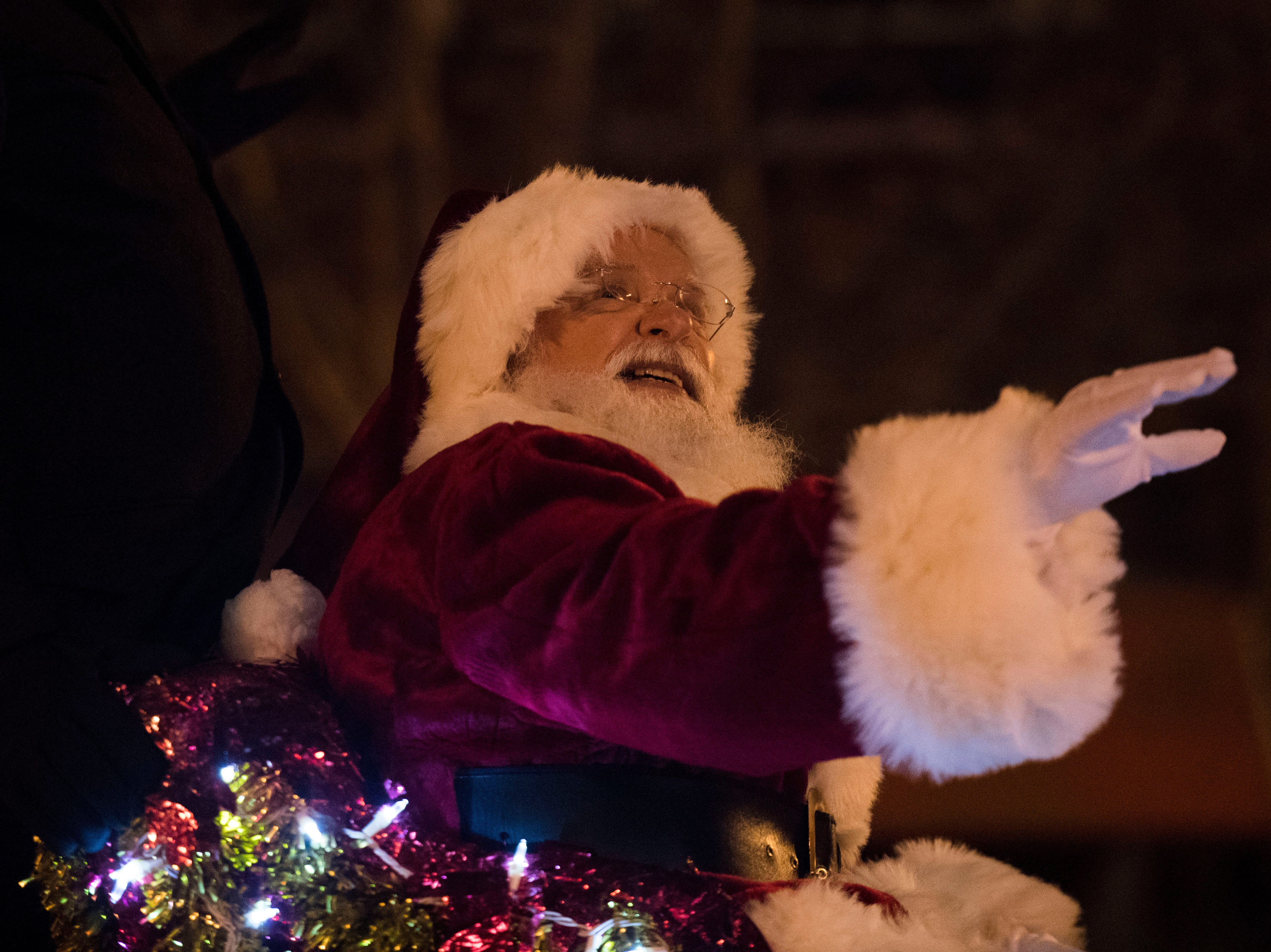 A man portraying Santa ends the annual WIVK Christmas Parade in downtown Knoxville Friday, Dec. 7, 2018.