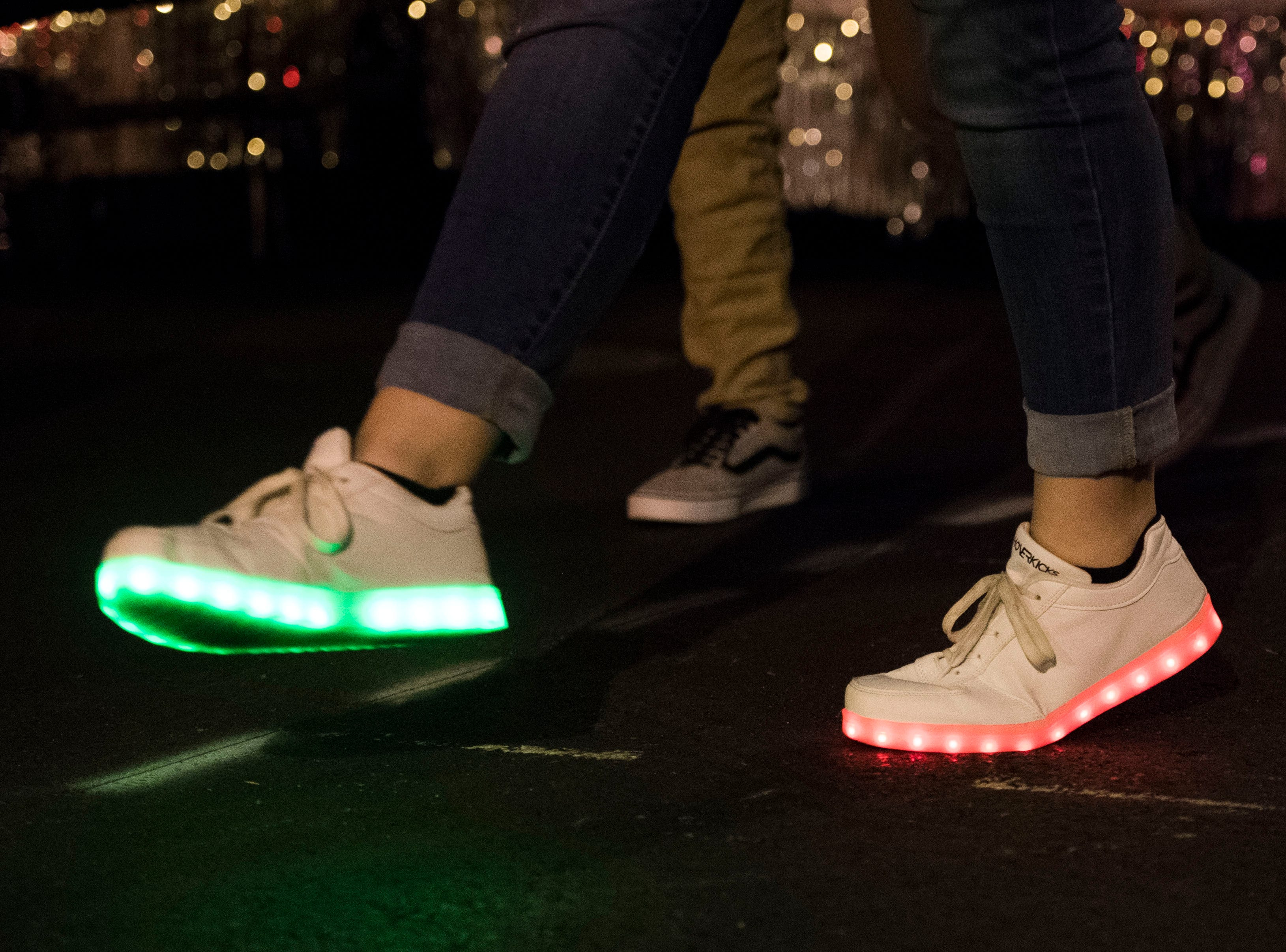 A parade marcher walks with light up shoes during the annual WIVK Christmas Parade in downtown Knoxville Friday, Dec. 7, 2018.