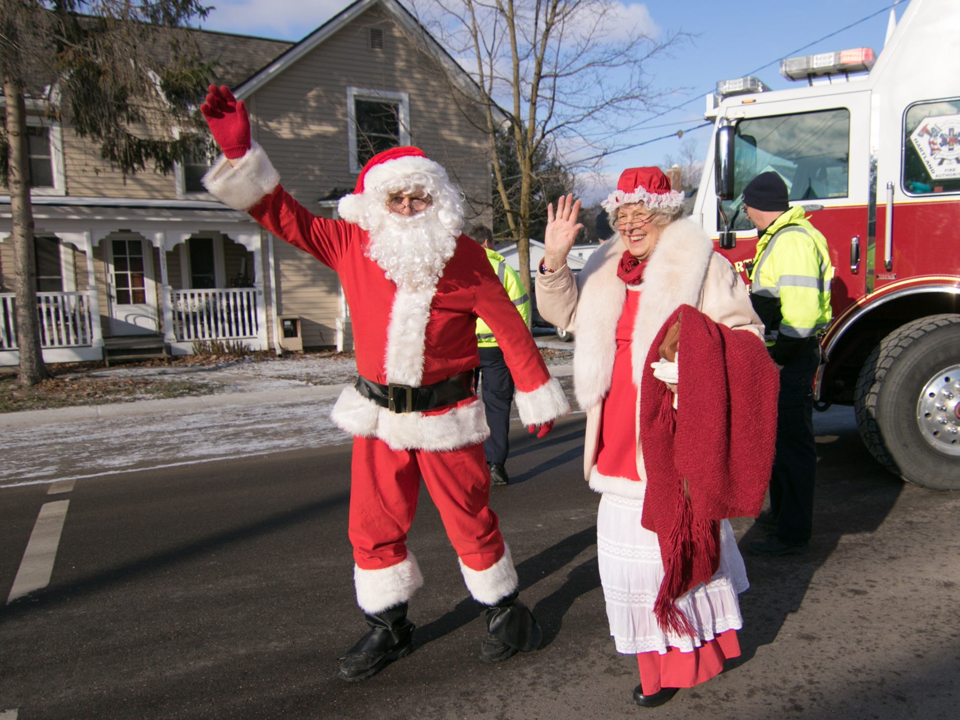 Santa and Mrs. Claus step down from a Hartland Area Fire engine, having been chauffeured by the department Saturday, Dec. 8, 2018 to Hartland's Polar Express Day event.