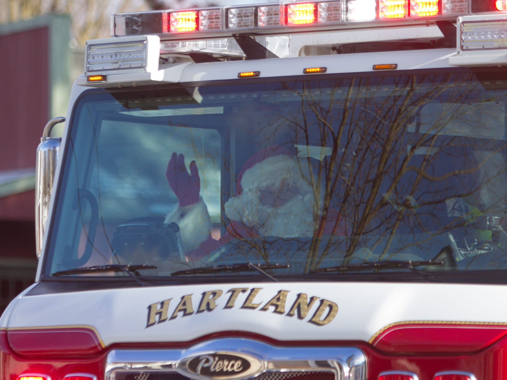 Santa arrives via a Hartland Area Fire Department engine Saturday, Dec. 8, 2018 for Hartland's Polar Express Day.