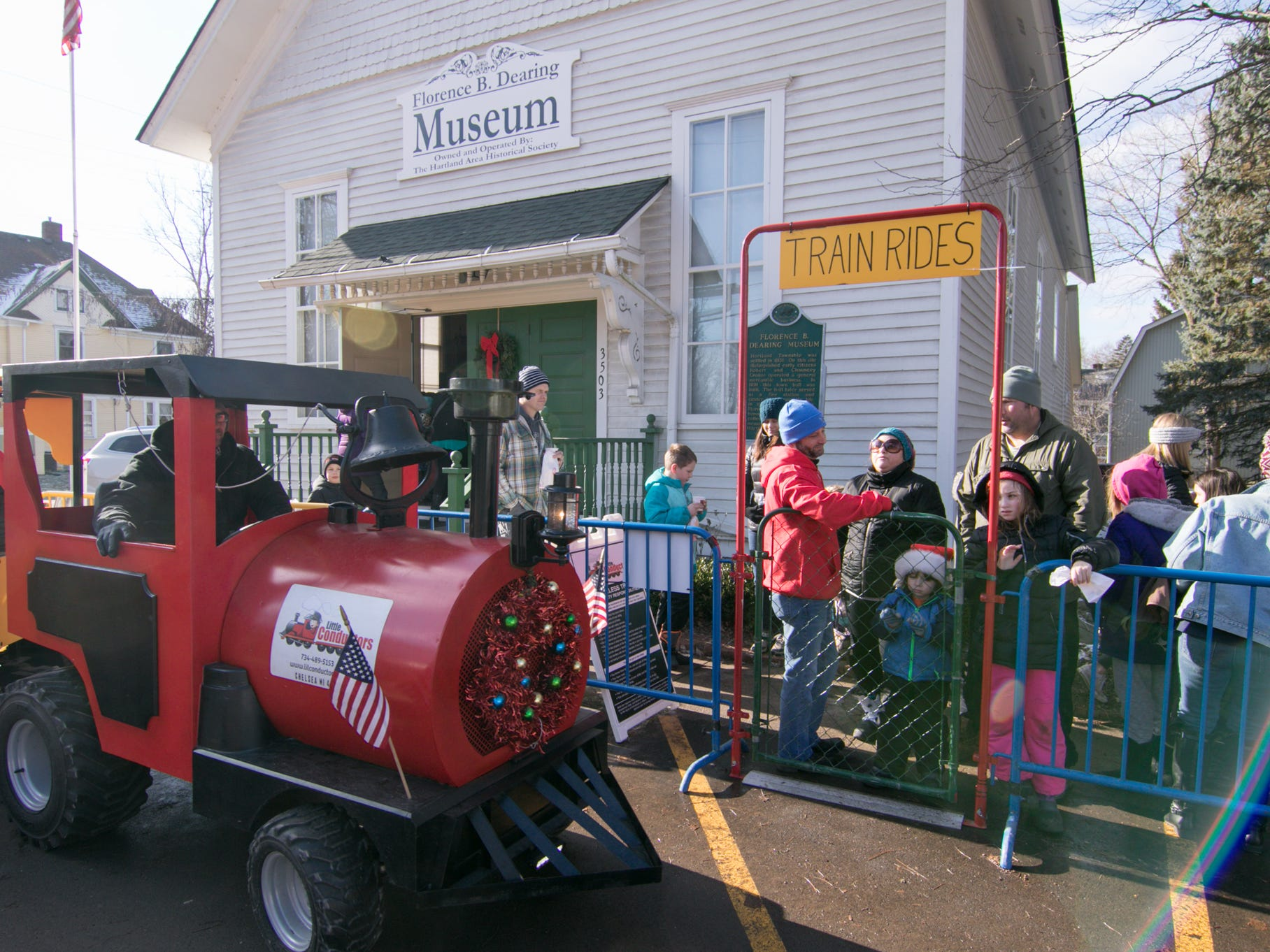 Polar Express Day attendees line up to board a miniature train provided by Little Conductors at the winter event Saturday, Dec. 8, 2018.