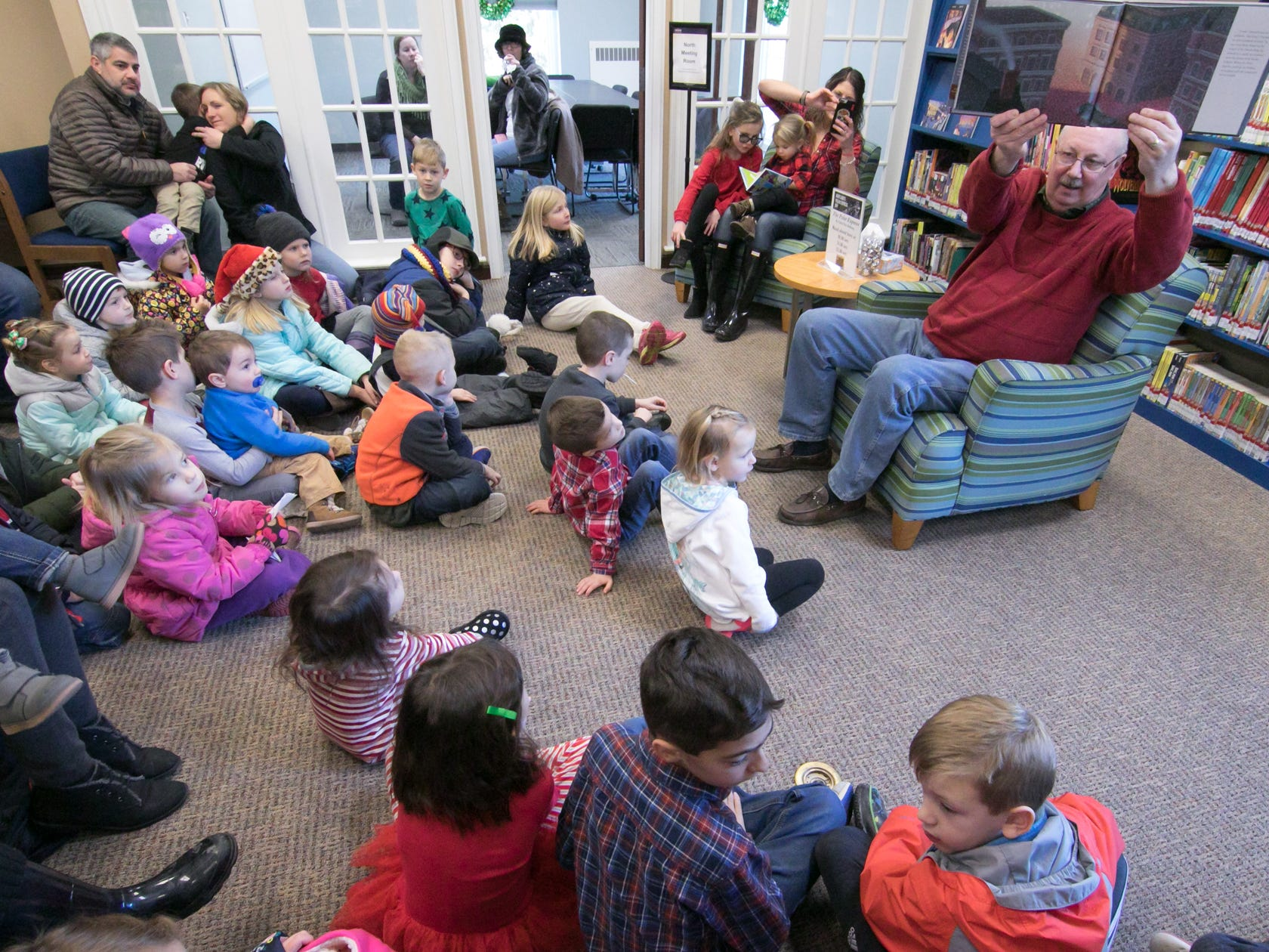 "Chris Van Allsburg's ""The Polar Express"" is read by Jim Michalak at Polar Express Day Saturday, Dec. 8, 2018 inside Hartland Cromaine Library."