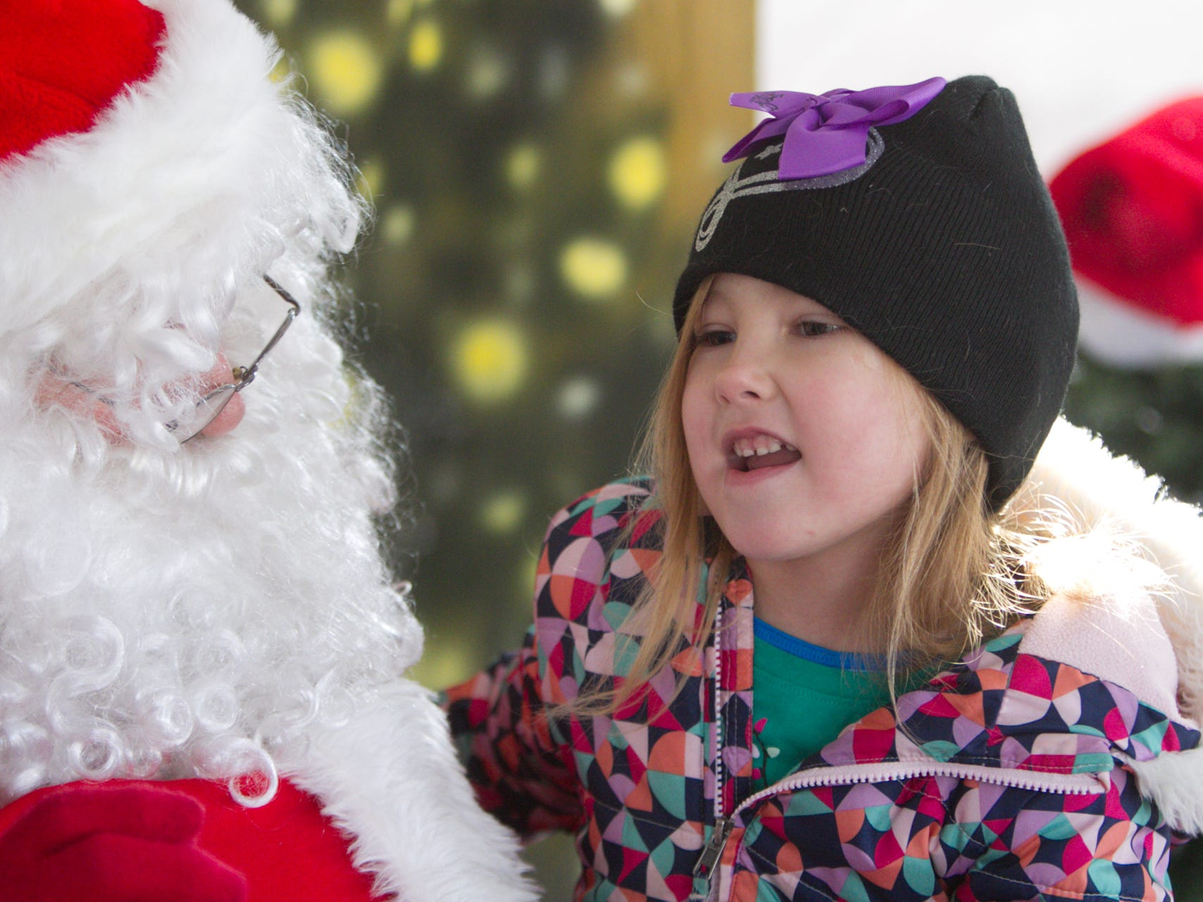 5-year-old Adelyn Heinsch tells Santa she wants a puppy for Christmas at Hartland's Polar Express Day Saturday, Dec. 8, 2018.