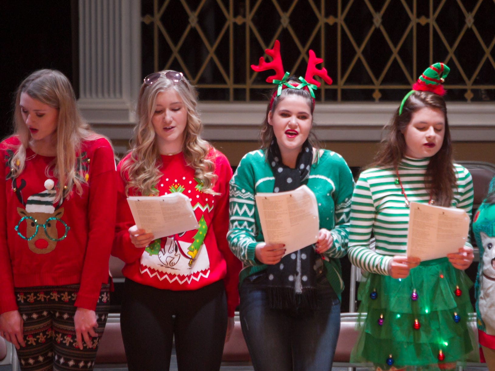Members of Hartland High School's choir sing at the Hartland Music Hall for Polar Express Day Saturday, Dec. 8, 2018.