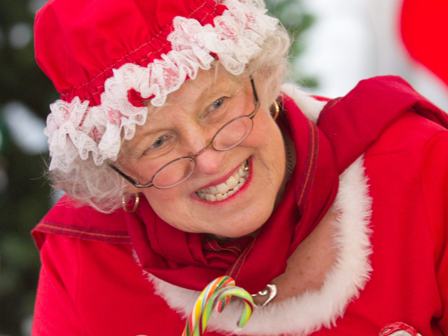 Mrs. Claus offers candy canes to children Saturday, Dec. 8, 2018 after they've told Santa what they want for Christmas, at Hartland's Polar Express.