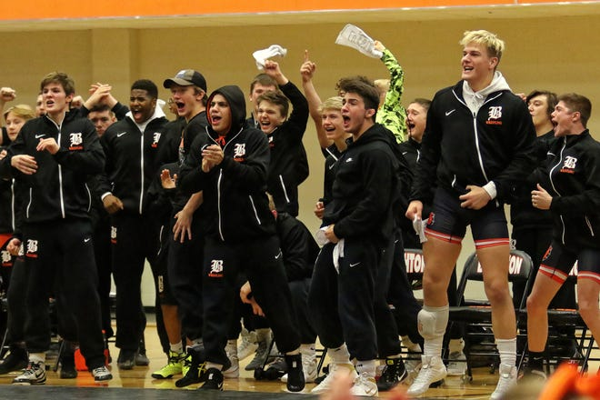 Brighton wrestlers react after Aiden Smith's victory at 103 pounds clinched the dual meet against Davison.
