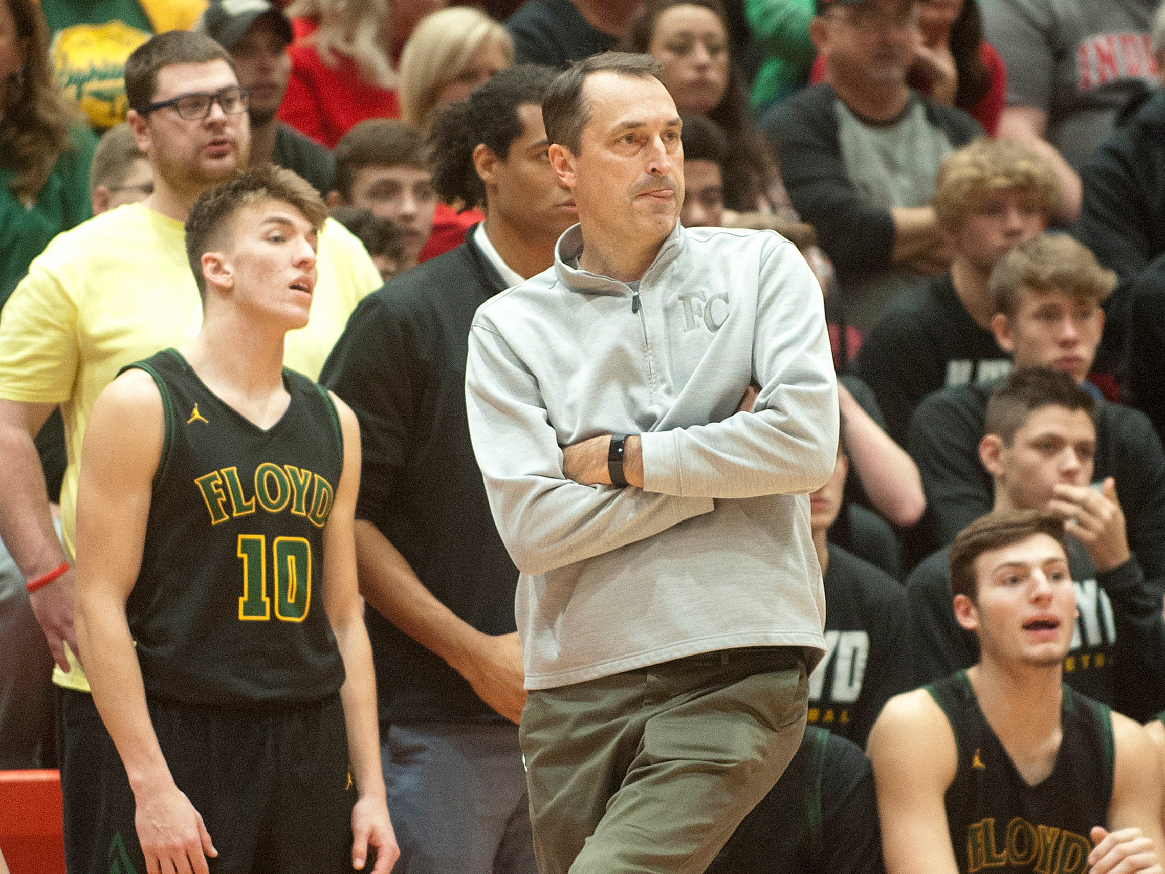 Floyd Central head basketball coach Todd Sturgeon gives a little body English as he hopes a foul call will go his way during the game.07 December 2018
