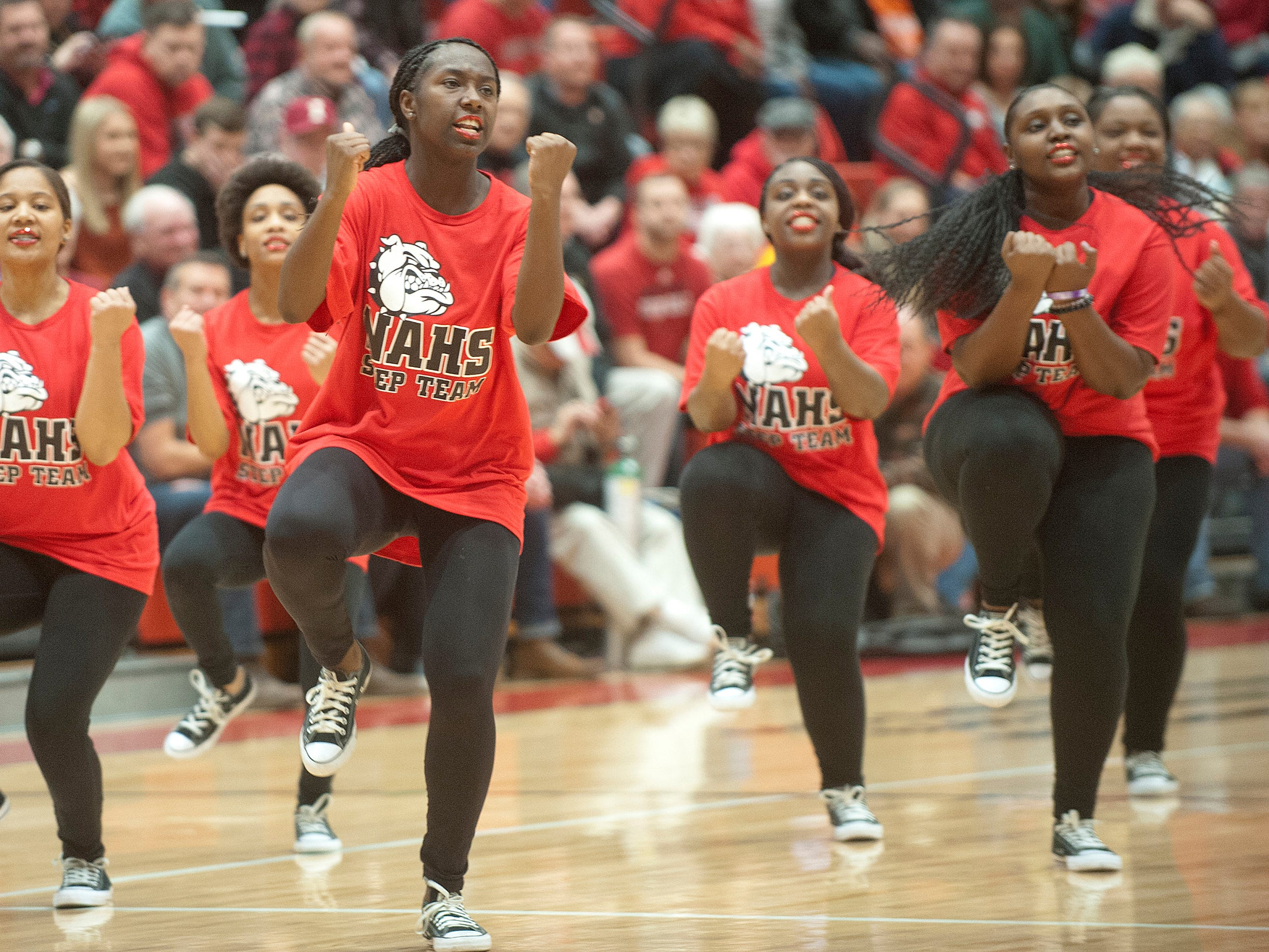 The New Albany step team performs at the half. 07 December 2018