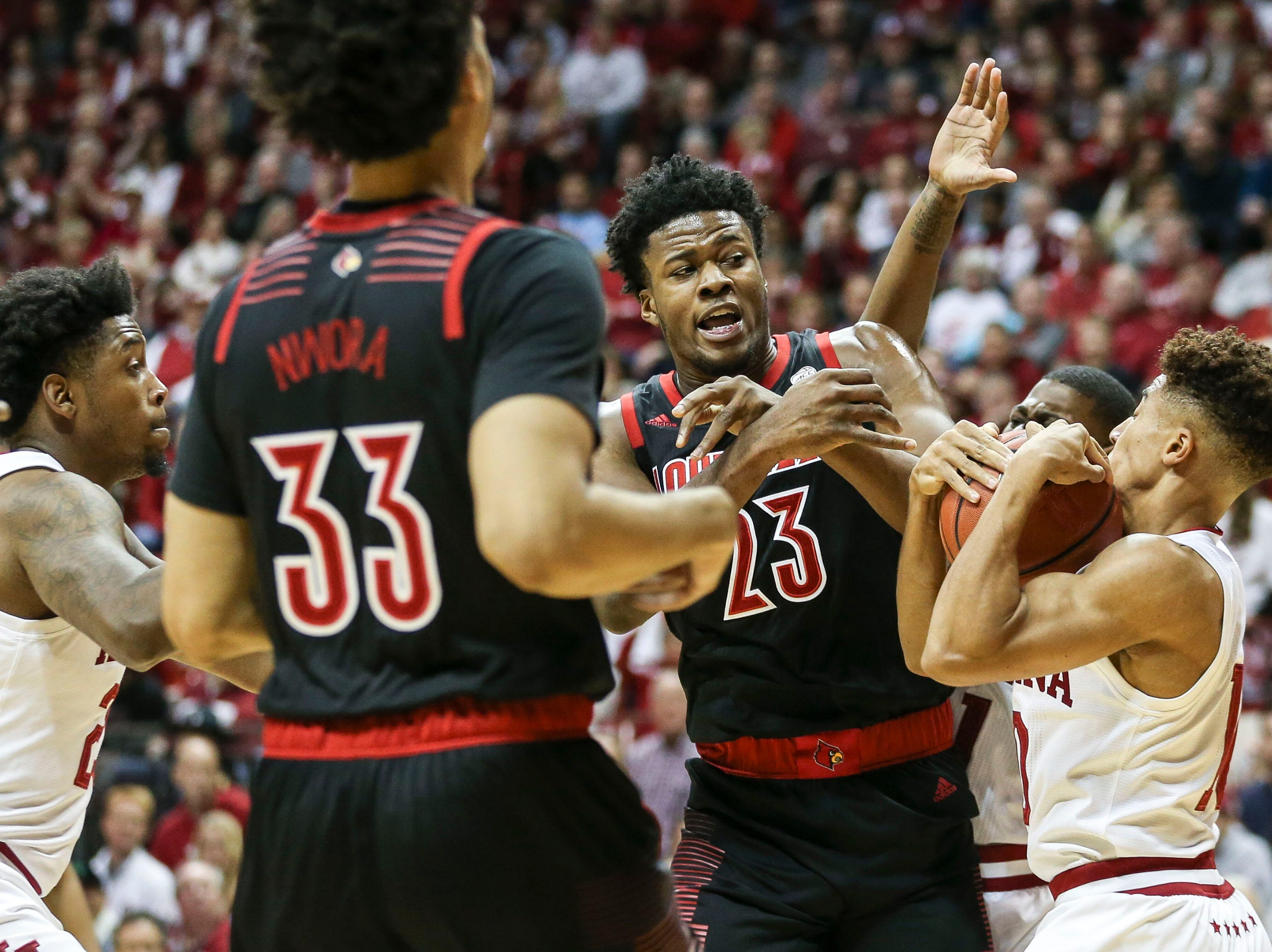 Louisville's Steven Enoch loses control of the ball against Indiana's Rob Phinisee in the second half Saturday, Dec. 8, 2018 at Simon Skjodt Assembly Hall in Bloomington, Ind.