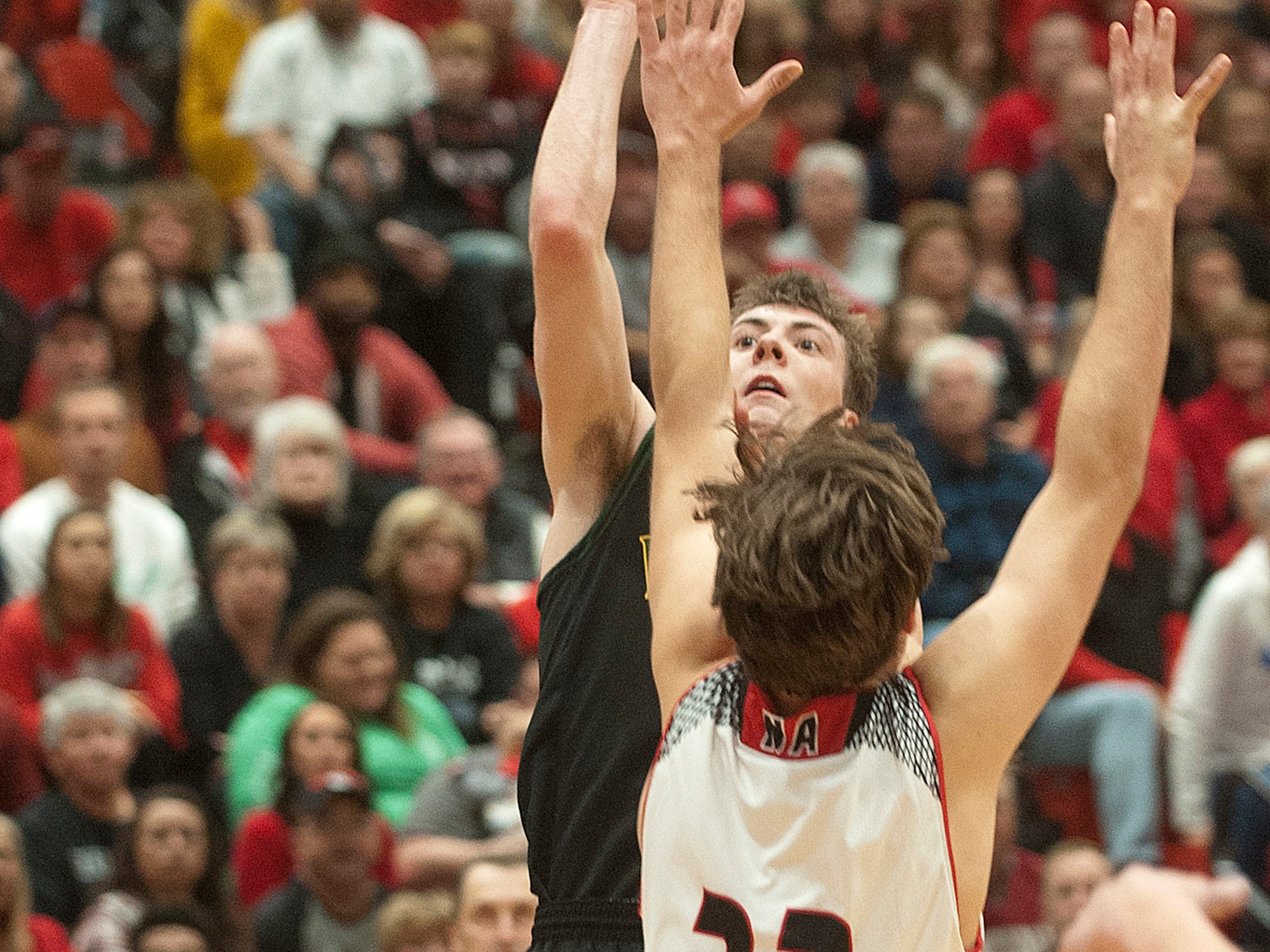 Floyd Central guard Nick Winchell shoots over New Albany forward Trey Hourigan. 07 December 2018