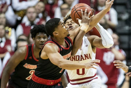 Louisville's Christen Cunningham battles for the ball with Indiana's Romeo Langford Saturday, Dec. 8, 2018 at Simon Skjodt Assembly Hall in Bloomington, Ind. Langford finished with 21 points.