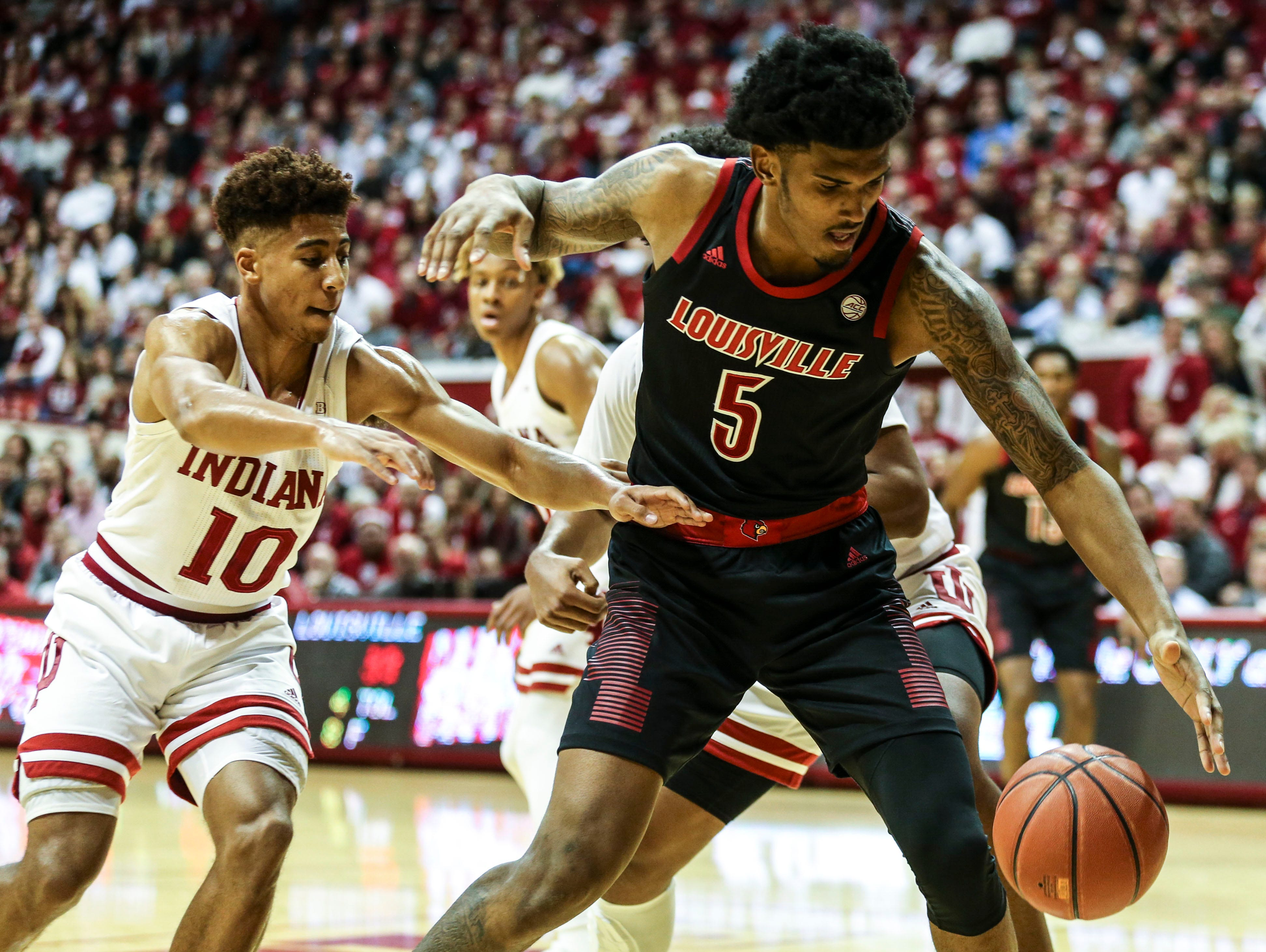 "Louisville's Malik Williams is pressured by Indiana's Rob Phinisee Saturday, Dec. 8, 2018 at Simon Skjodt Assembly Hall in Bloomington, Ind. ""We couldn't establish anything inside today,"" said Mack afterwards. The Hoosiers beat Louisville 68-67"