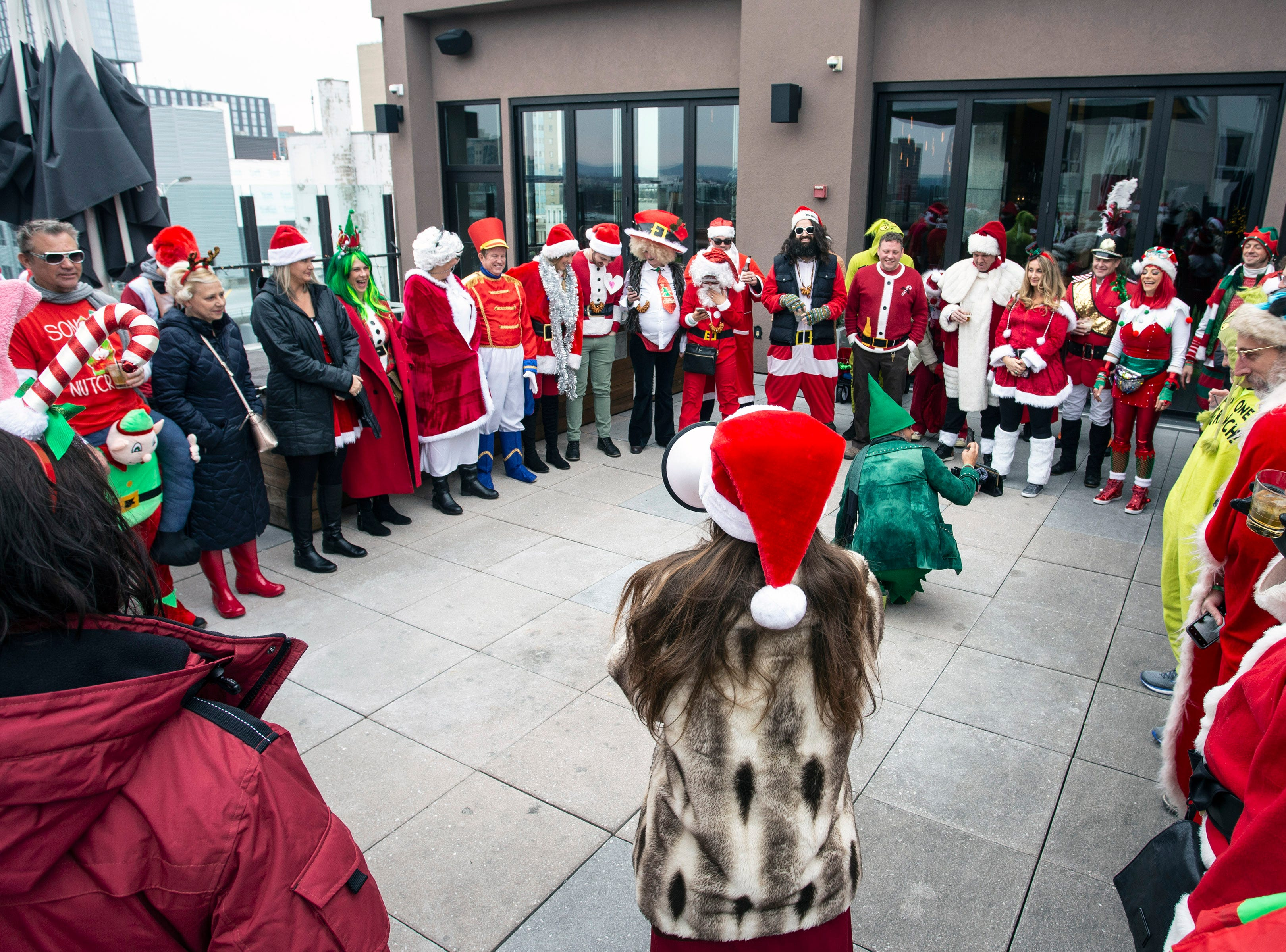 """Participants in Saturday's SantaCon began the day at 8UP with a rooftop breathing exercise that ended with the festive phrase """"ho-ho-ho"""" before embarking on a journey of good will. 12/8/18"""